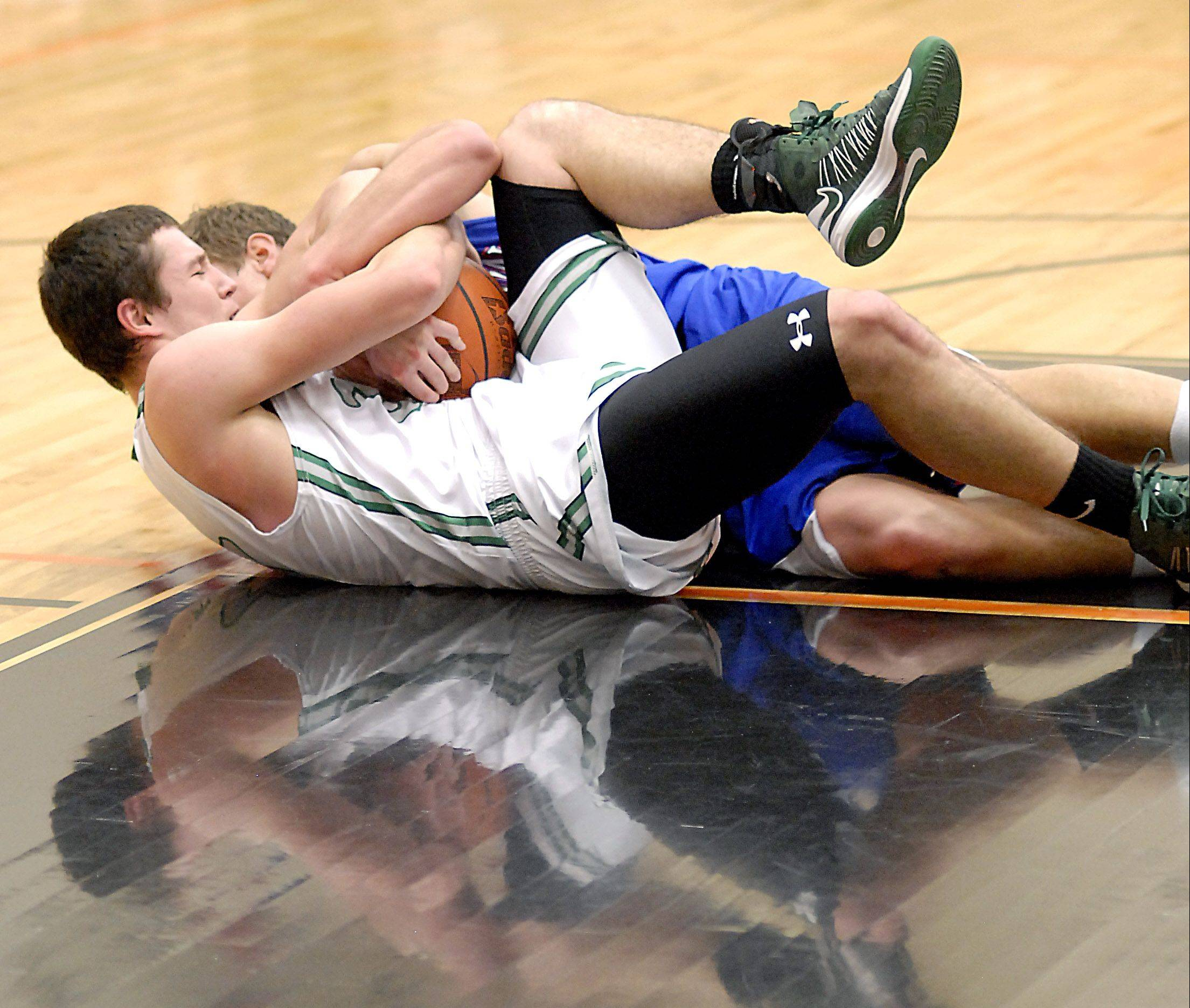 Geneseo's Grant Burress and Marmion's Matt Smith wrestle for a loose ball.