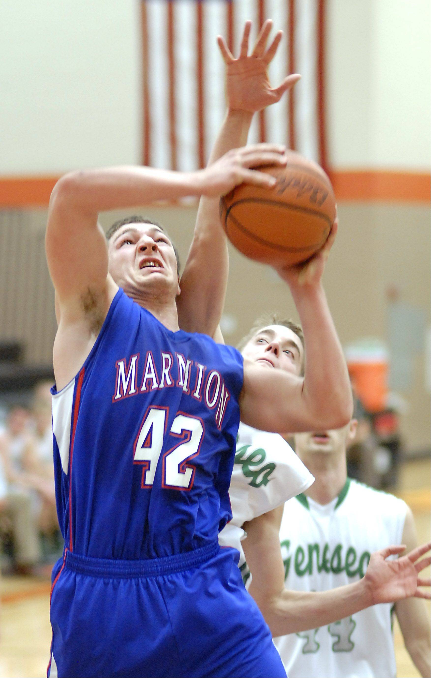 Marmion's Jordan Glasgow shoots during a block by Geneseo's Ethan Reschke in the fourth quarter of the DeKalb tournament on Saturday, December 22.