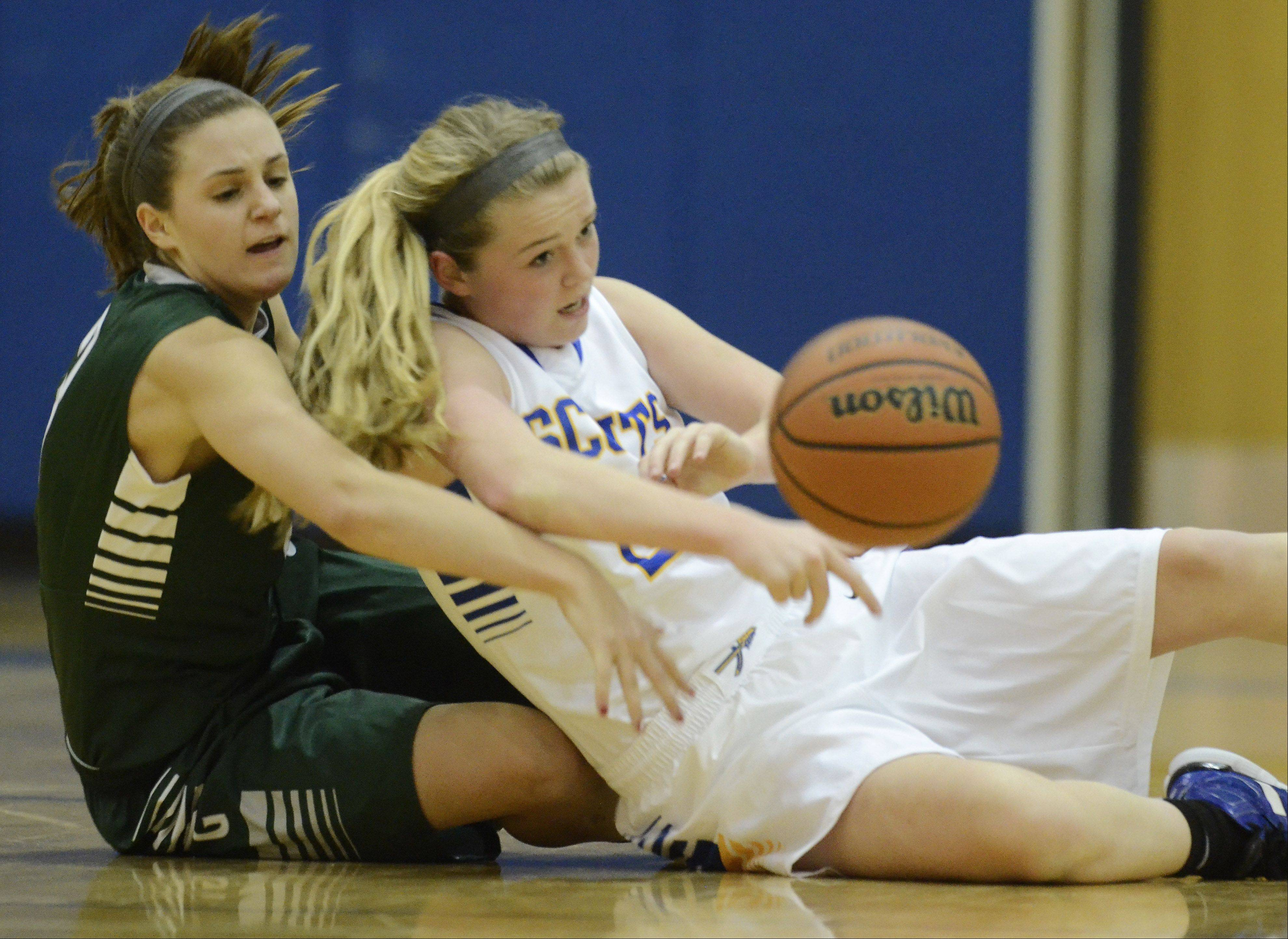 Grayslake Central's Savannah Mudd, left, and Lake Forest's Brooke Green go to the floor for a loose ball during Saturday's game at Warren.