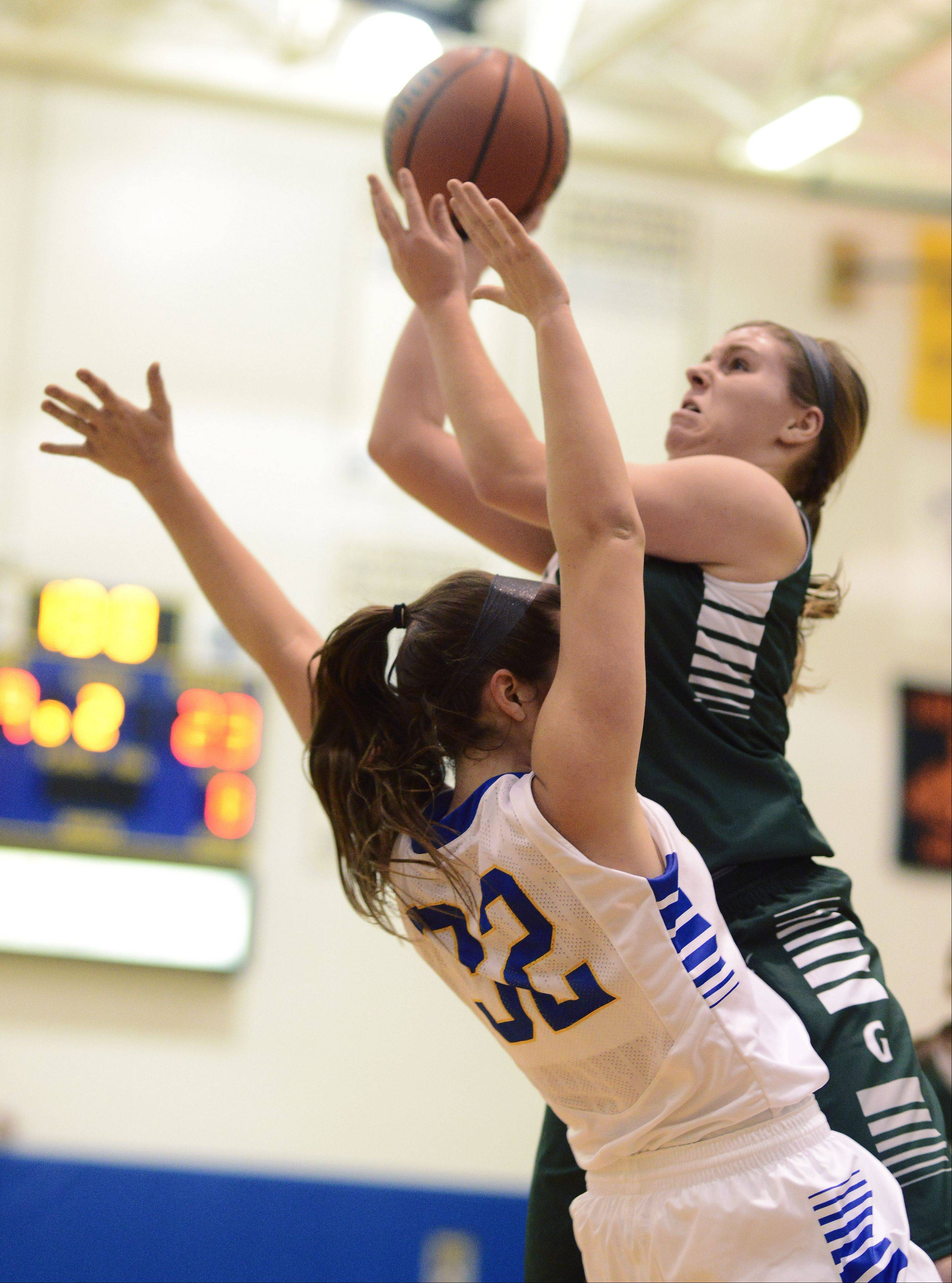 Graylake Central's Maddy Miller, right, draws contact from Lake Forest's Annie Keller during Saturday's game at Warren.