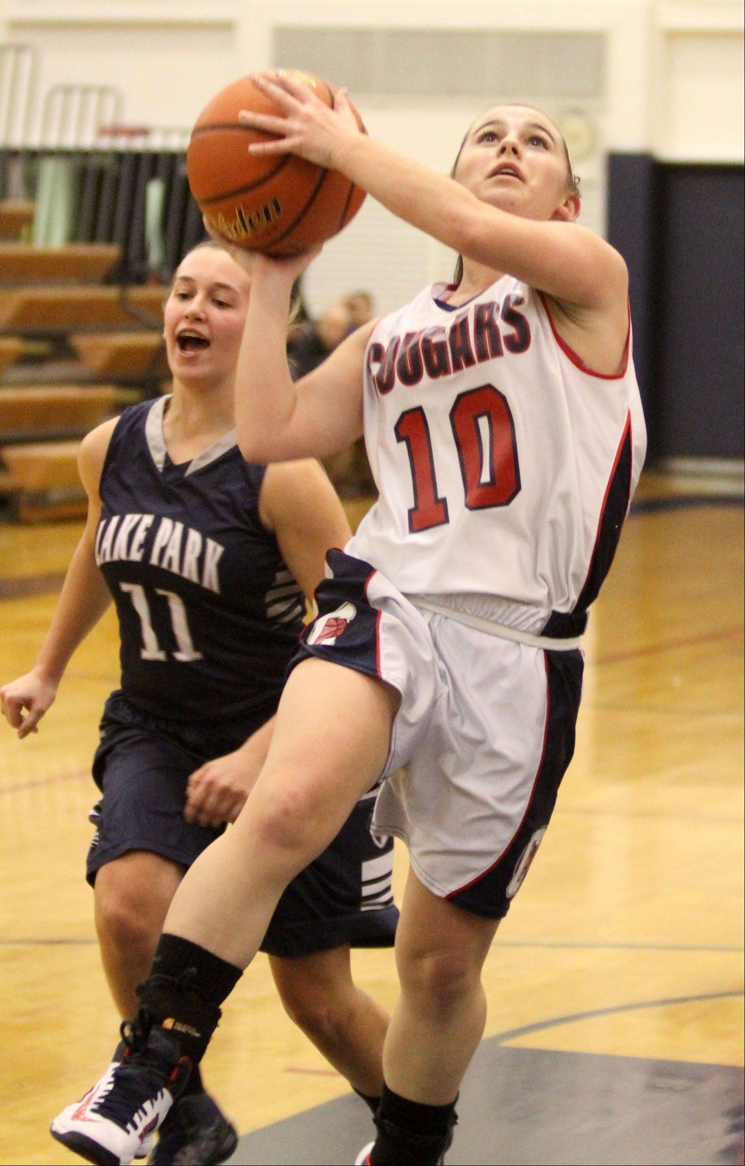 Conant's Sidney O'Keefe puts up a breakaway layup with Lake Park defender Emily Duckhorn trailing the play on Saturday.