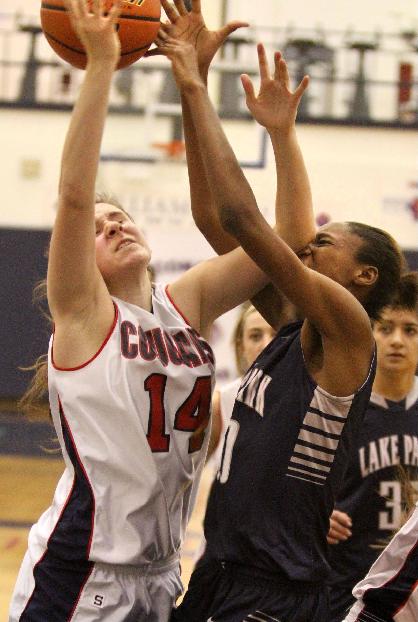 Conant's Sarah Mazurek, left, and Lake Park's Tyshai Freeman collide while leaping for a rebound Saturday at Conant.