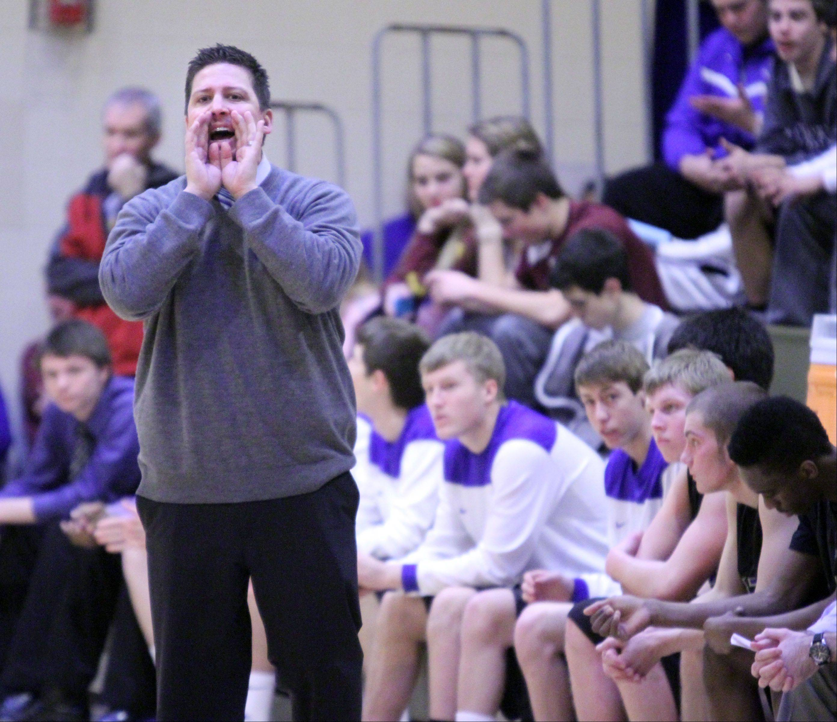 Wheeling coach Anthony Como takes in the action against Loyola in Wheeling on Wednesday.