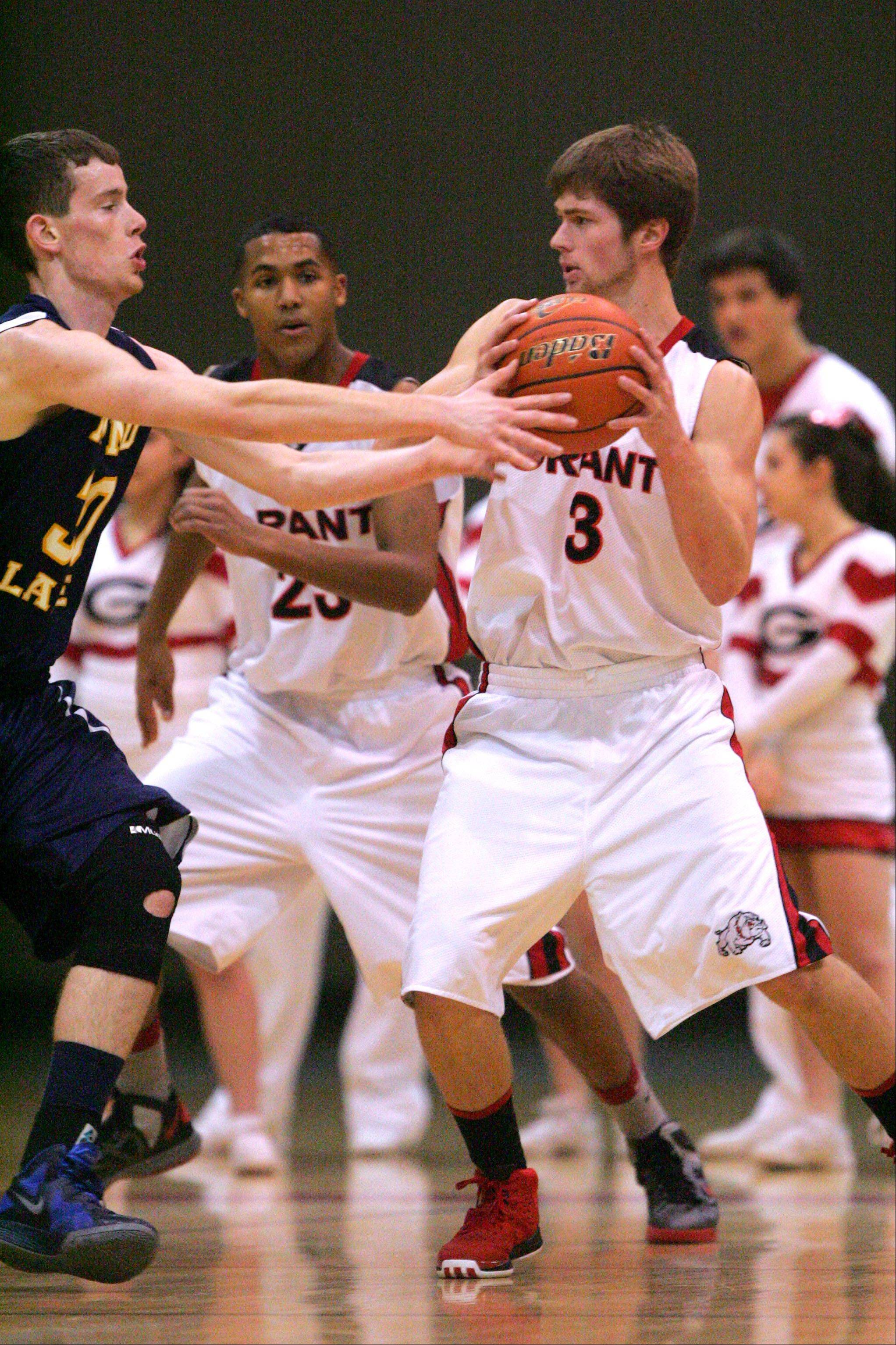 Images from the Round Lake vs. Grant boys basketball game on Wednesday, December 26 in Fox Lake.