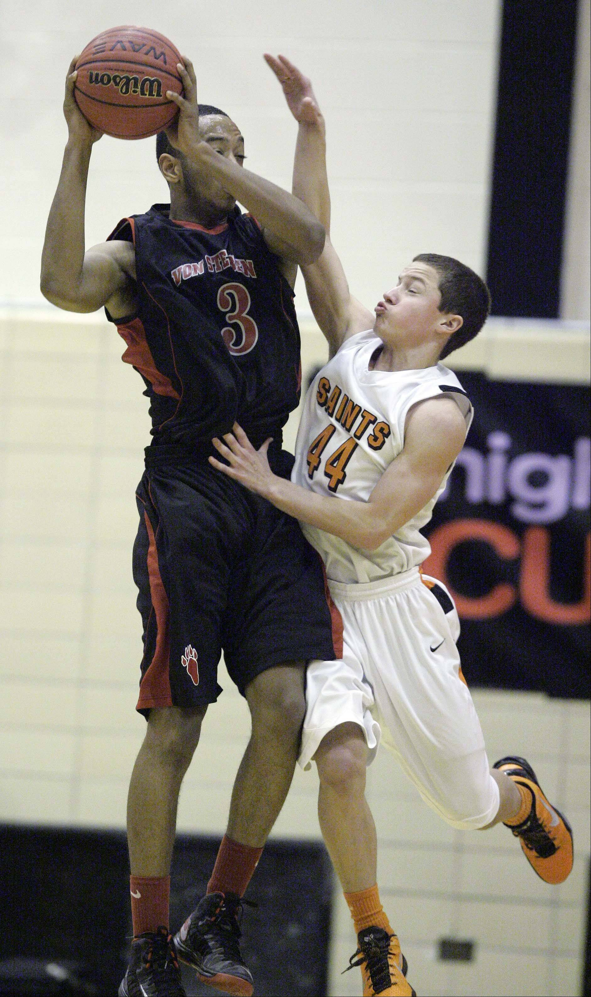 St. Charles East's Cole Gentry, 44, puts the pressure on Von Steuben's Joeseph Rencher, 3, at the Proviso West Holiday Tournament in Hillside, Wednesday December 26, 2012.