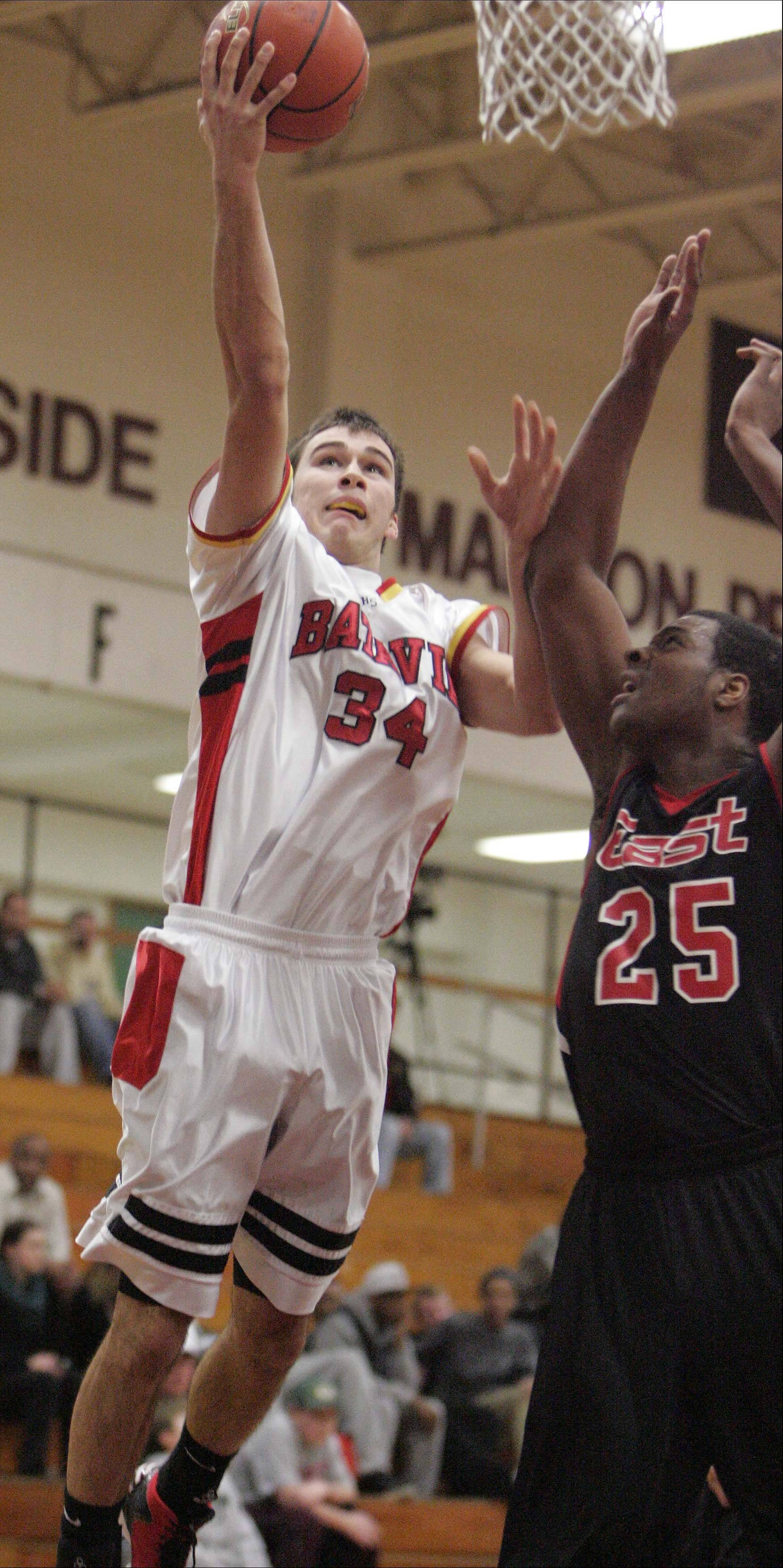 Zach Strittmatter soars in for a basket against Rockford East.