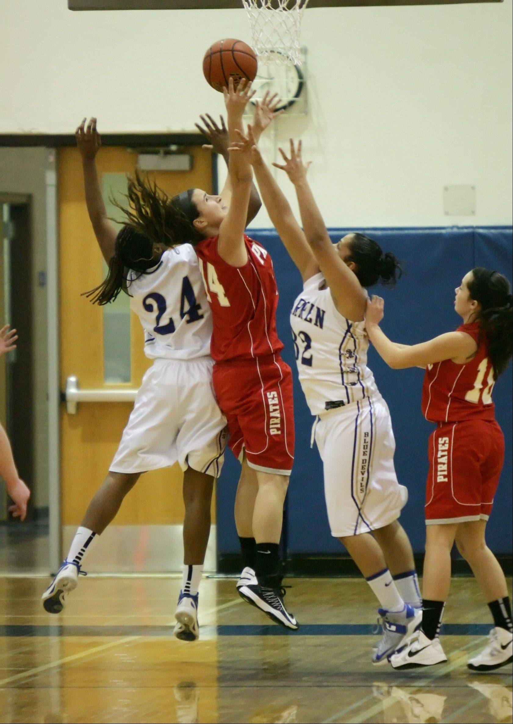 Images from the Palatine vs. Warren girls basketball game on Thursday, December 27 in Gurnee.