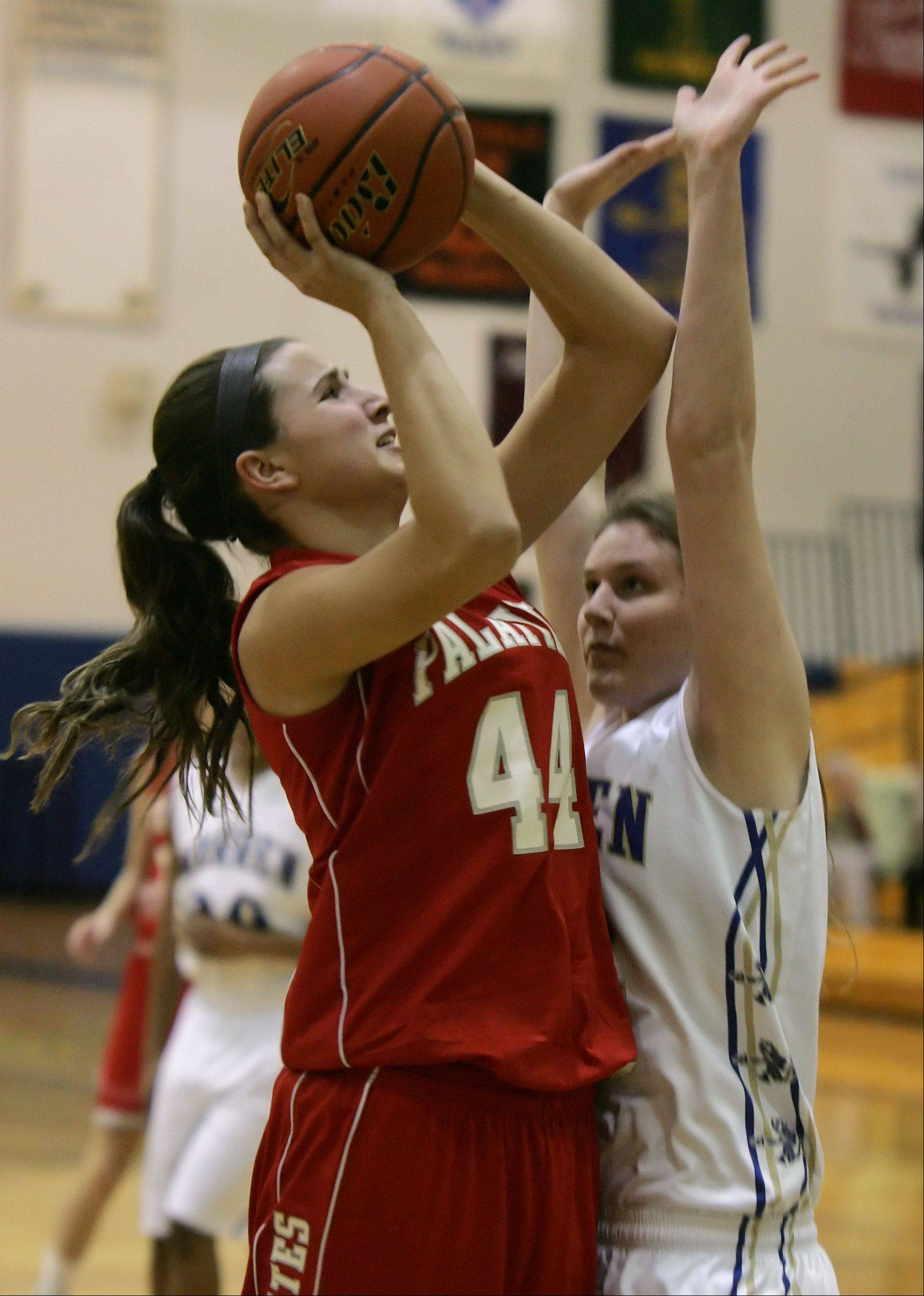 Palatine center Monica Masini shoots over Warren center Kristin Jacobs during the Palatine at Warren girls high school basketball game in the Blue Devil Classic Thursday at Warren High School in Gurnee.