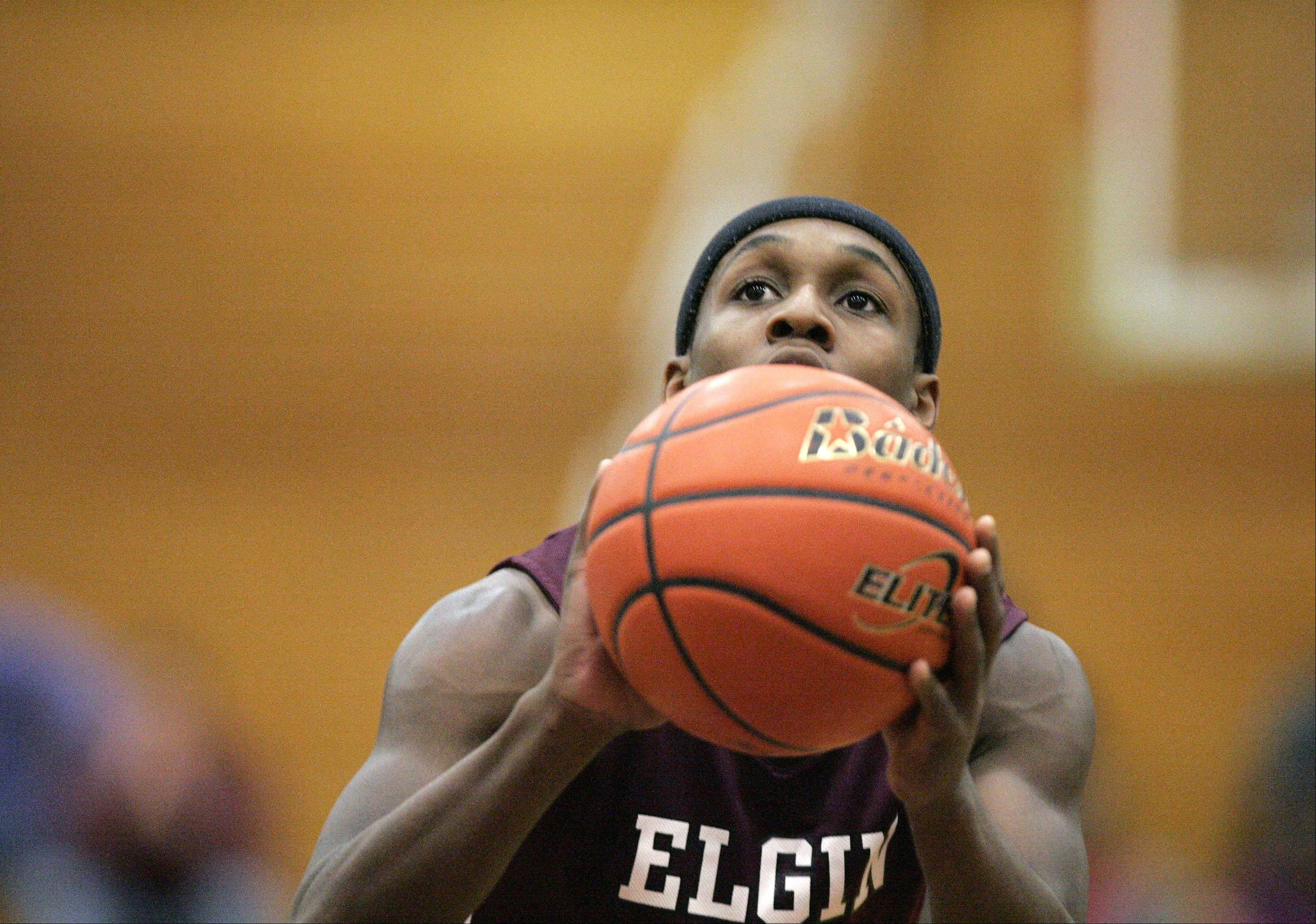 Elgin wing Arie Williams (10) shoots one of his free-throws against Dundee-Crown at the 38th Annual Elgin Boys Holiday Basketball Tournament Thursday December 27, 2012.