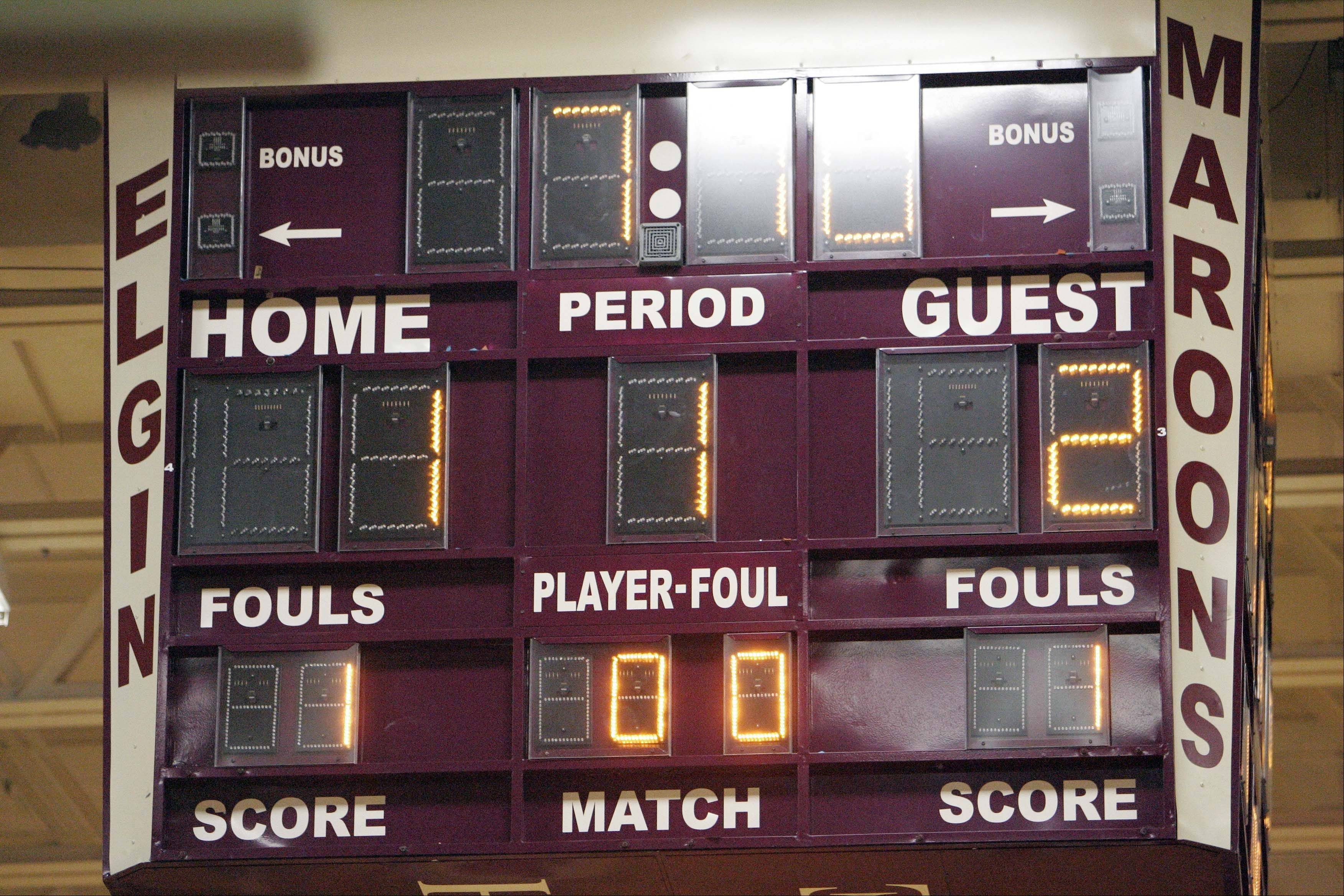 The score board showing Elgin wing Arie Williams (10) push over 1000 points in the Elgin vs Dundee-Crown game at the 38th Annual Elgin Boys Holiday Basketball Tournament Thursday December 27, 2012.