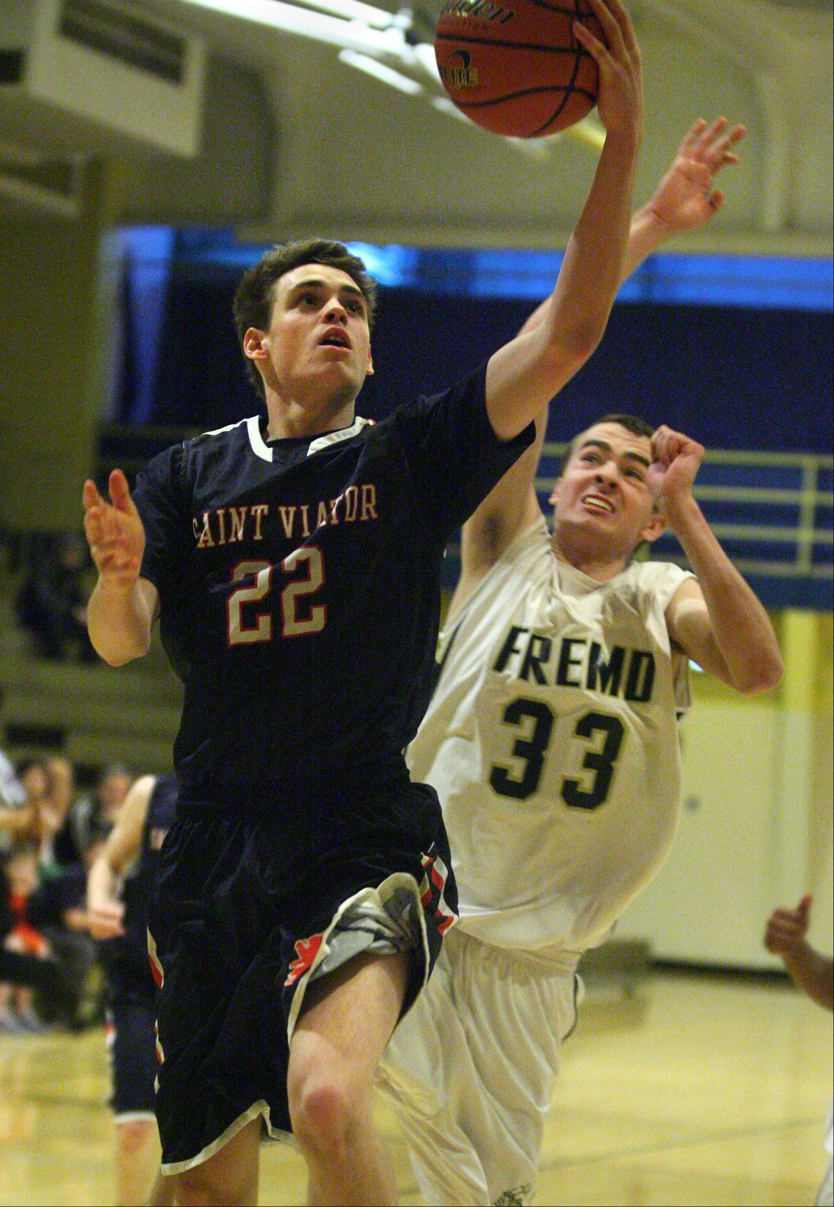 St. Viator's Patrick Martin shoots with Fremd defender Sean Benka trailing in the 35th annual Wheeling Wildcat Hardwood Classic on Thursday.