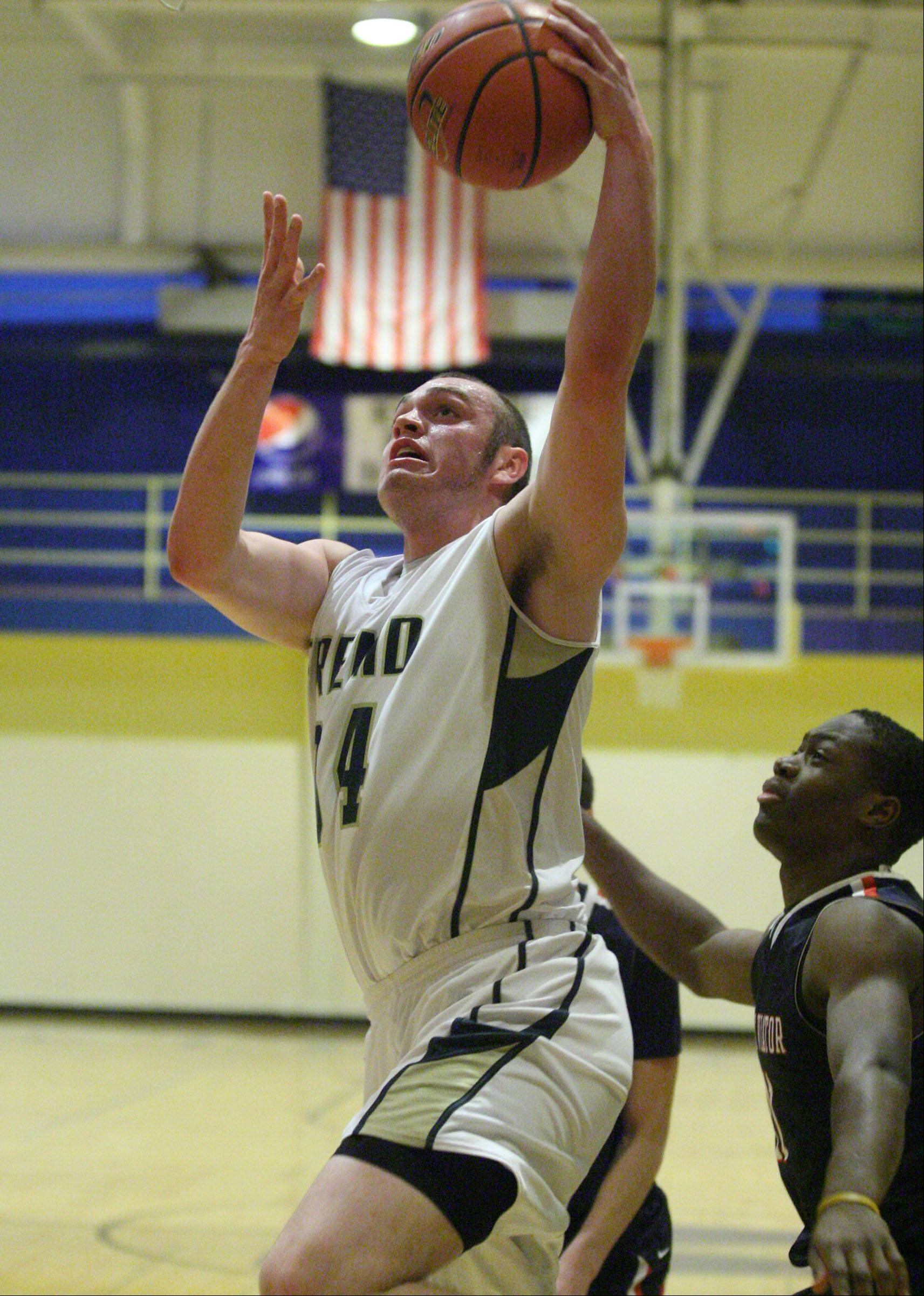 Fremd's Ben Carlson shoots against St. Viator at the 35th annual Wheeling Wildcat Hardwood Classic on Thursday.
