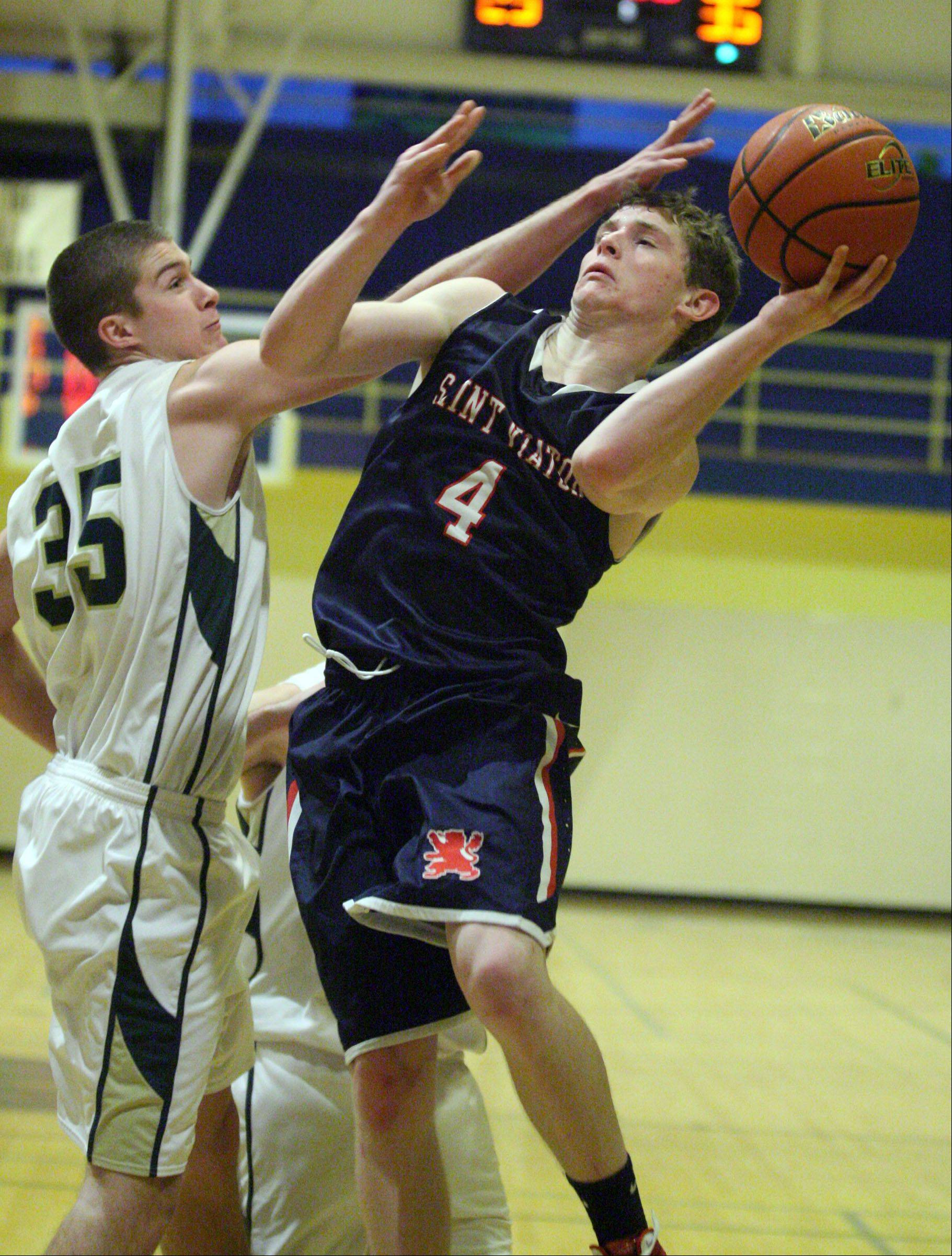 St. Viator's Kevin Hammarlund shoots against Fremd defender Tom Cordell in the 35th annual Wheeling Wildcat Hardwood Classic on Thursday.