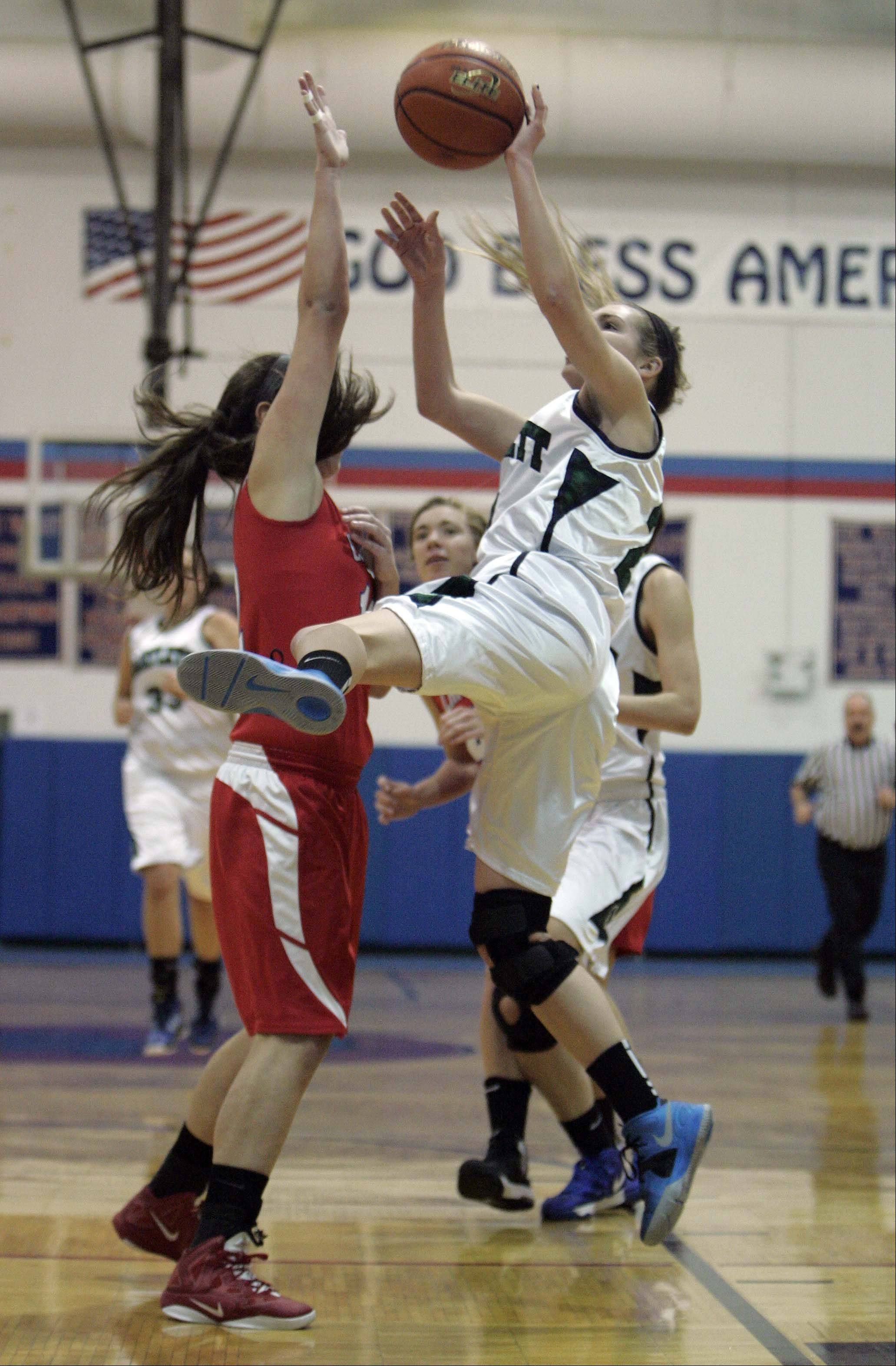 Dundee-Crown's Lauren Lococo applies some pressure as Bartlett's Chantel Zasada (21) goes up for a shot Thursday during the 30th annual Charger Classic Thursday at Dundee-Crown.