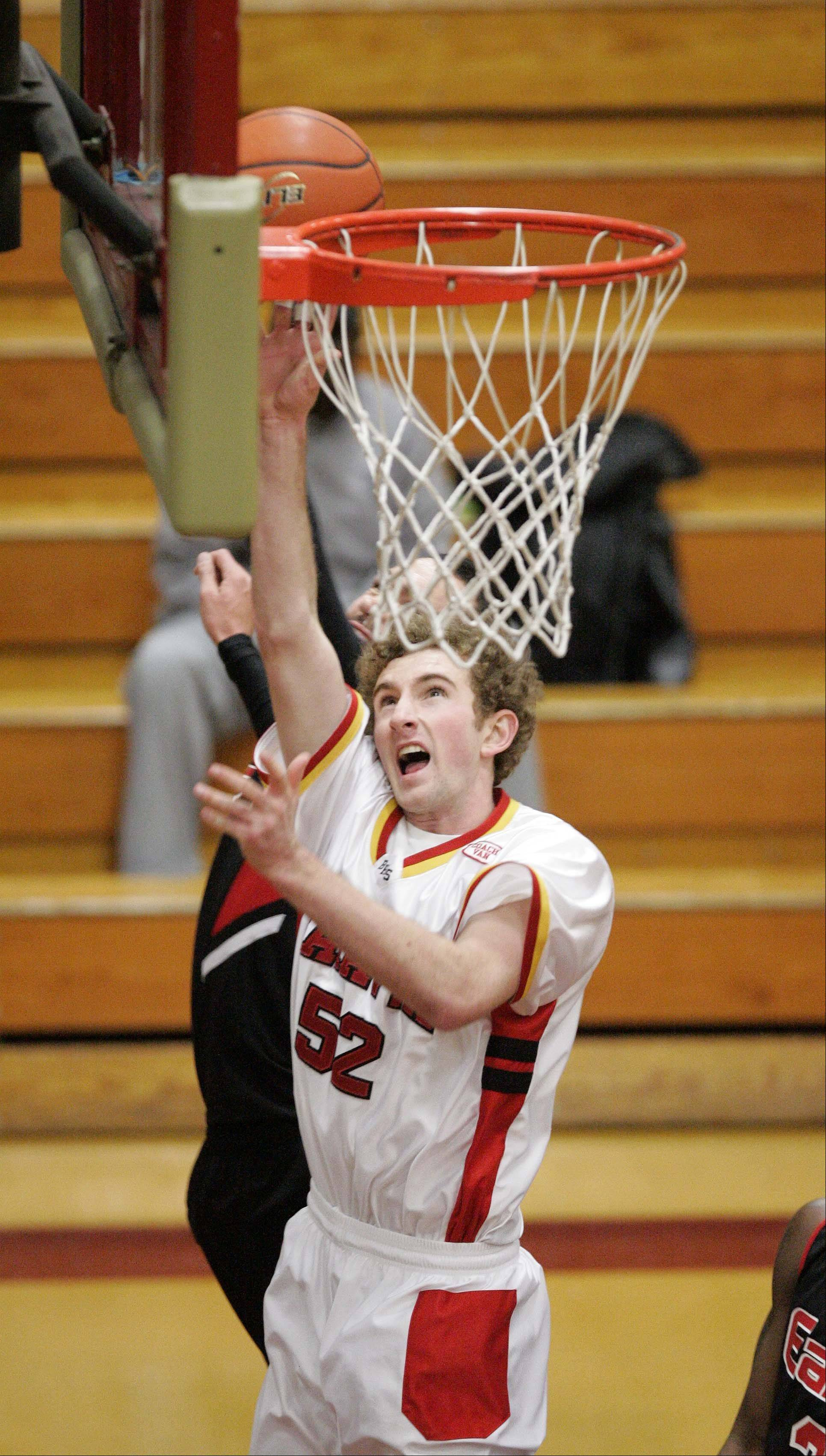 Batavia forward Luke Horton (52) goes hard to the hoop against Rockford East at the 38th Annual Elgin Boys Holiday Basketball Tournament Thursday December 27, 2012.