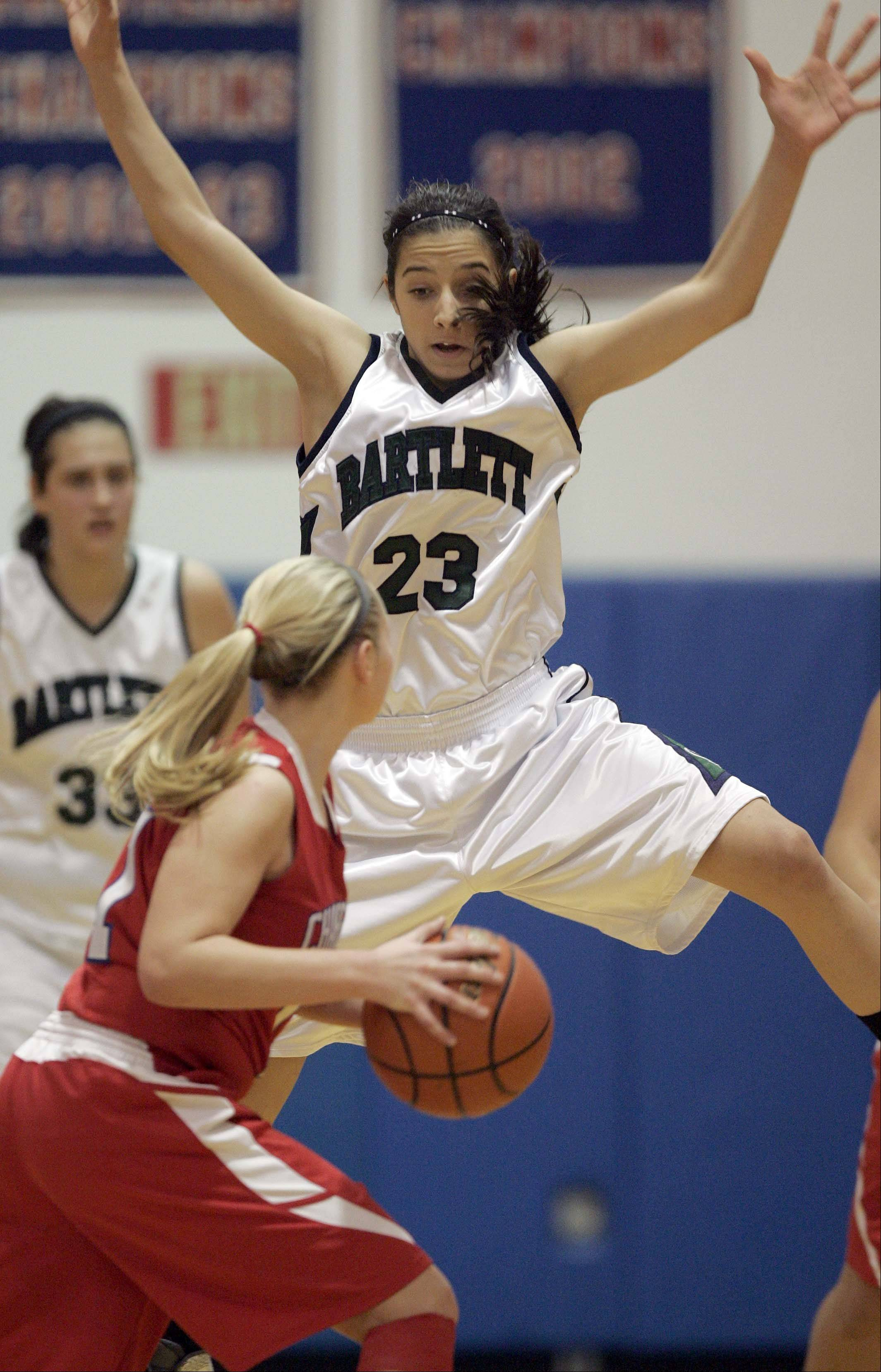 Bartlett's Ally Giampapa, 23, gets some air as she tries to defend Dundee-Crown's Jordan Bartelt, 11, pass during the Dundee-Crown 30th Annual Charger Classic girls basketball tournament Thursday December 27, 2012 at the Carpentersville School.