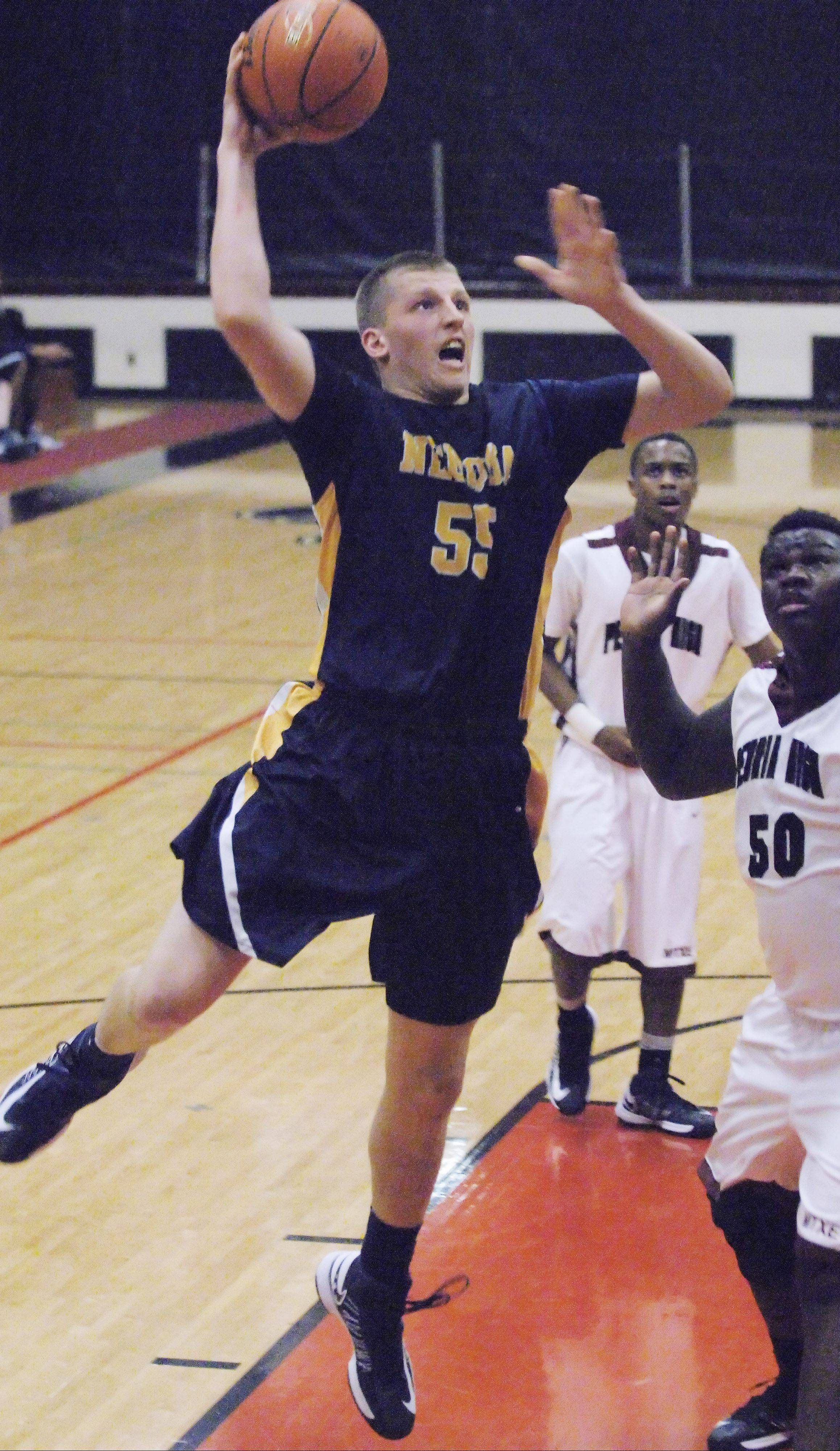 Neuqua Valley's Pat Kenny takes the ball to the hoop against Peoria Central on Friday at East Aurora.
