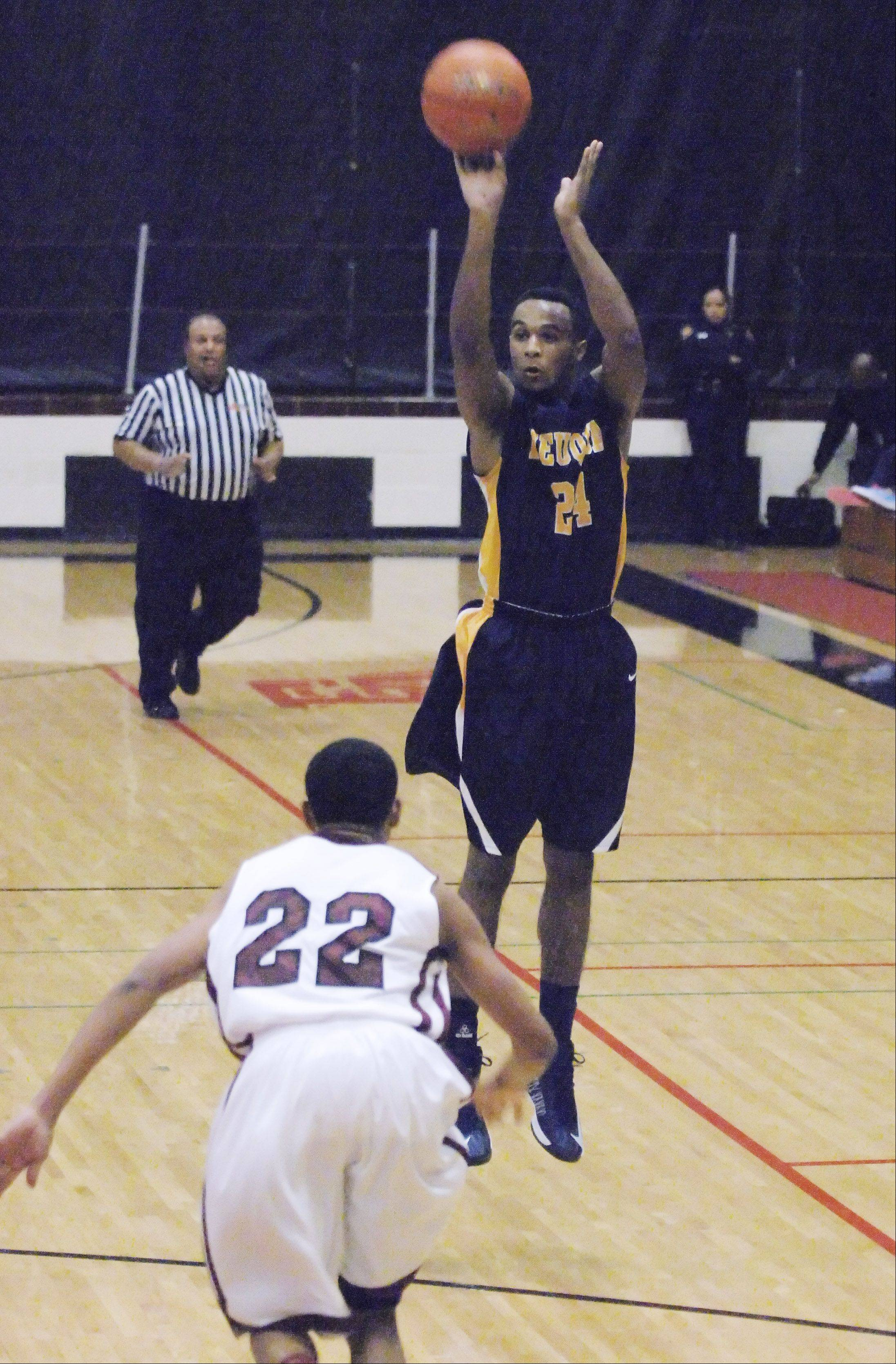 Jabari Sandifer of Neuqua Valley releases a 3-pointer against Peoria Central on Friday at East Aurora.