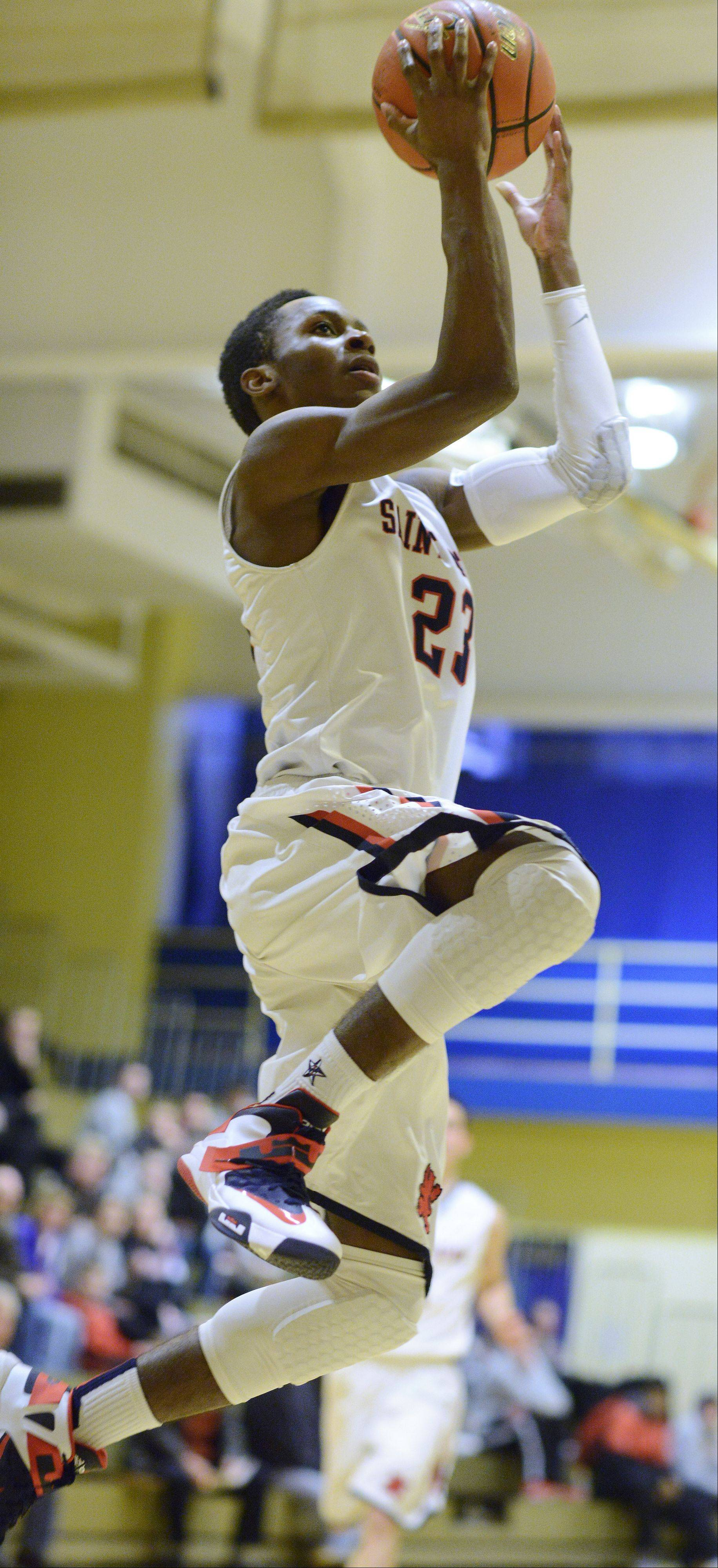 St. Viator's Ore Arogundade drives for a layup against Niles North during Friday's semifinal of the Wheeling Tournament.
