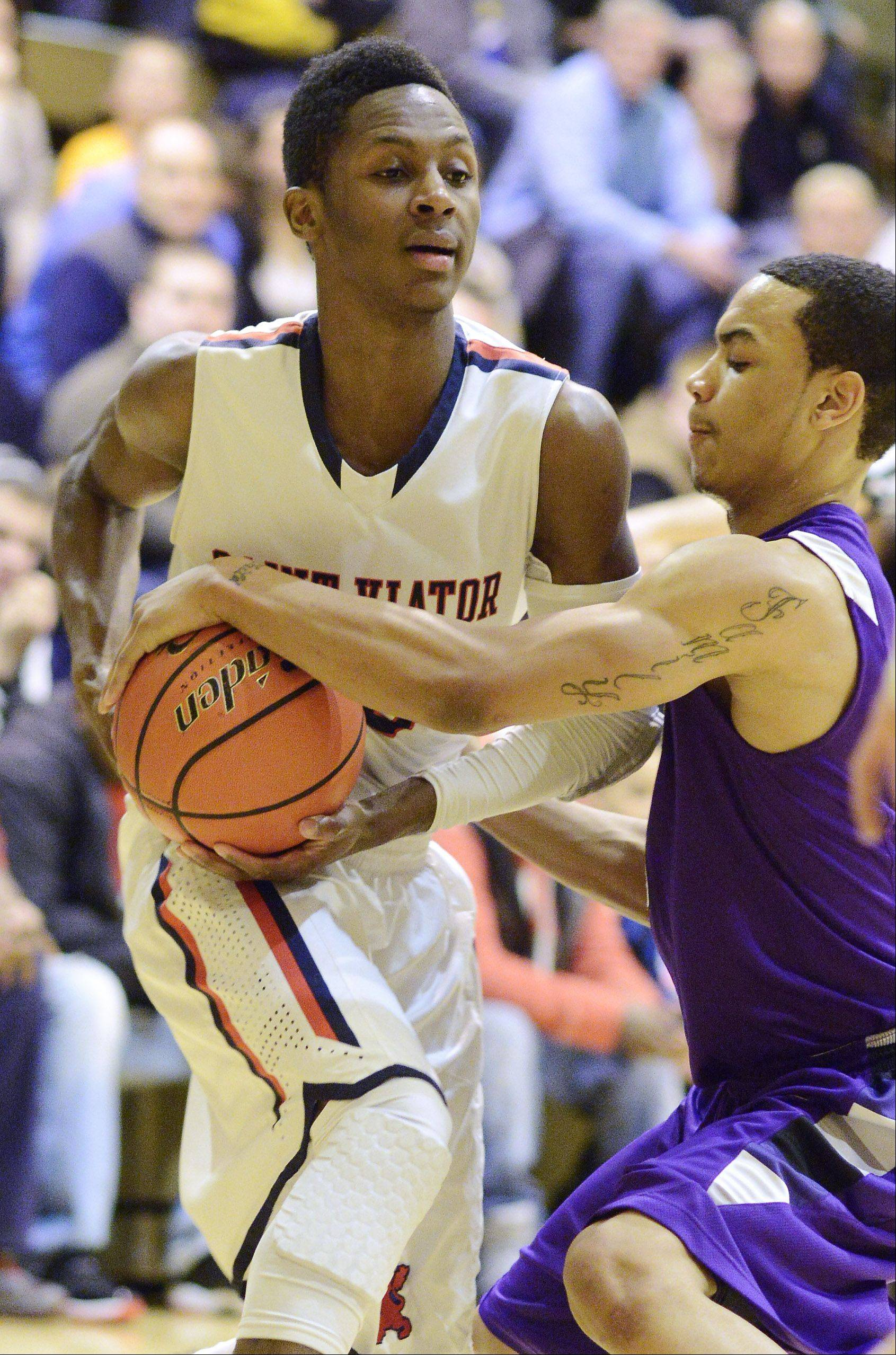 St. Viator's Ore Arogundade, left, has the ball taken away by Niles North's Lorenzo Dillard during Friday's semifinal of the Wheeling Tournament.