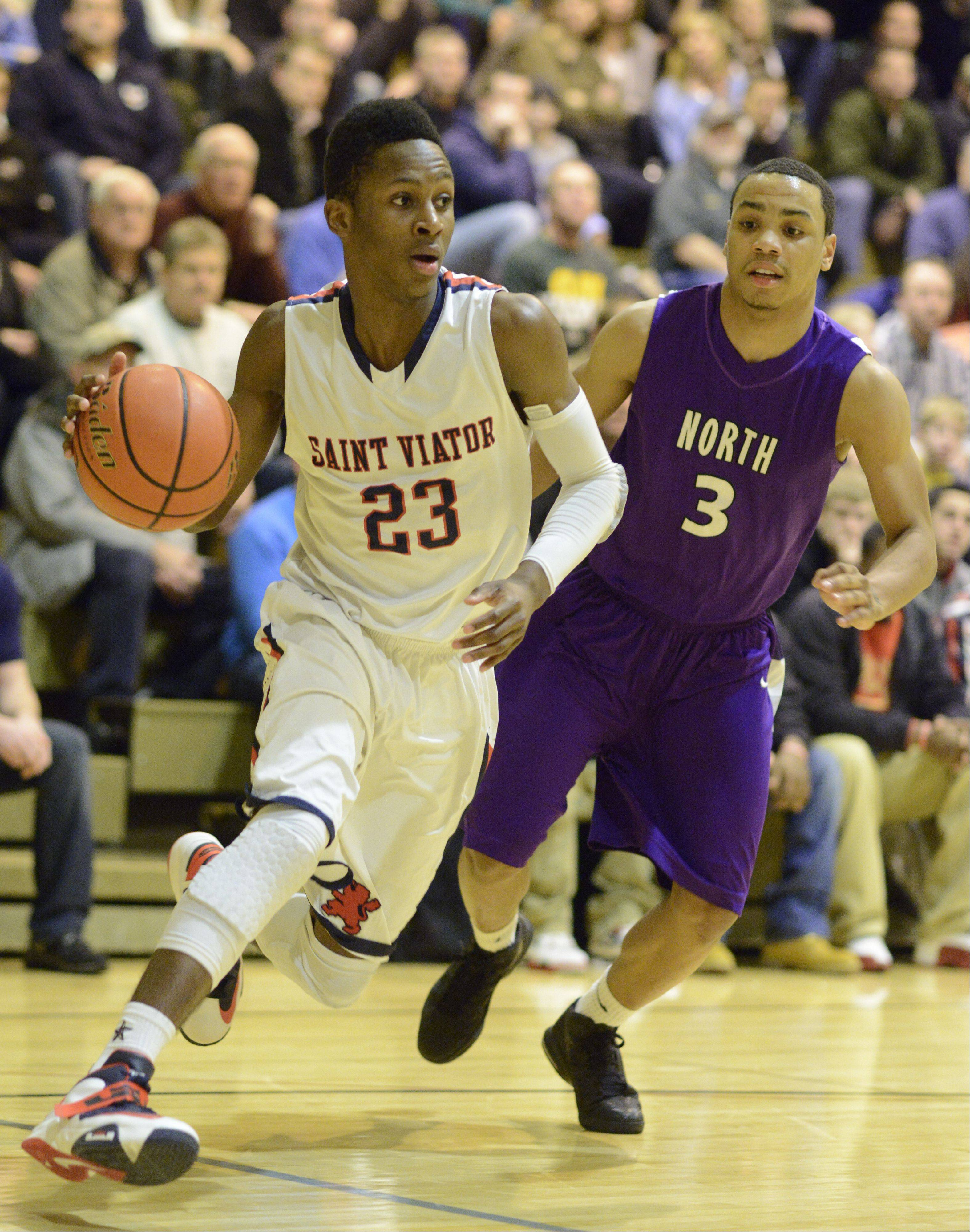 Images from the St. Viator vs. Niles North boys basketball game on Friday, December 28th, at the Wheeling High School holiday basketball tournament.