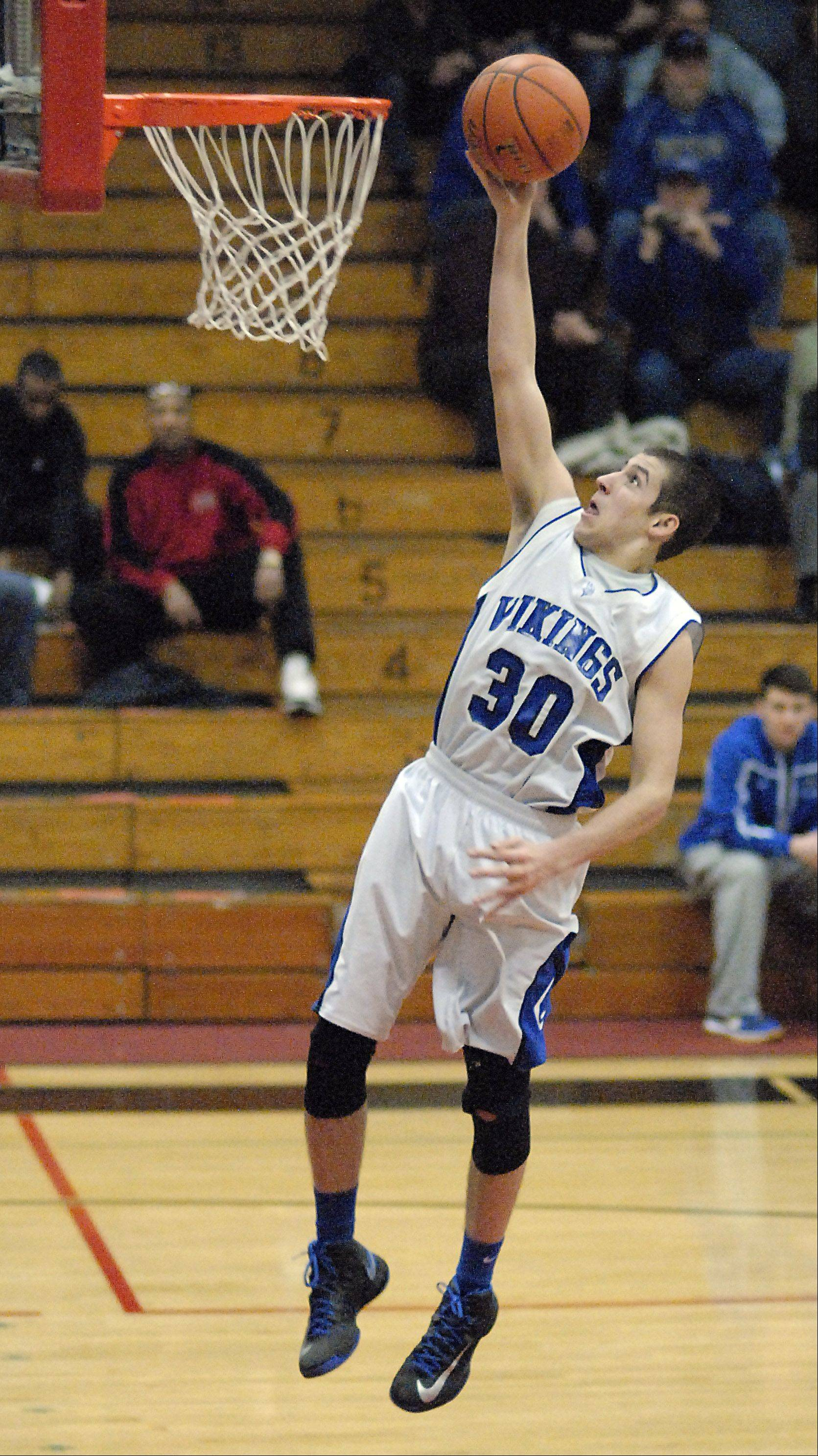 Geneva's Chris Parrilli sinks a shot with no one blocking his way in the fourth quarter on Friday, December 29.