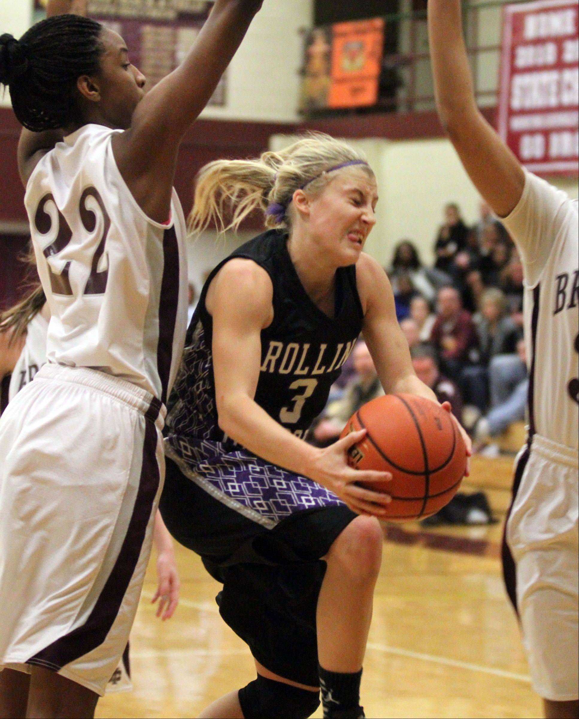 Rolling Meadows' Jackie Kemph shoots against Montini defender Malayna Johnson, left, in the championship game of Montini's holiday tournament in Lombard on Saturday.