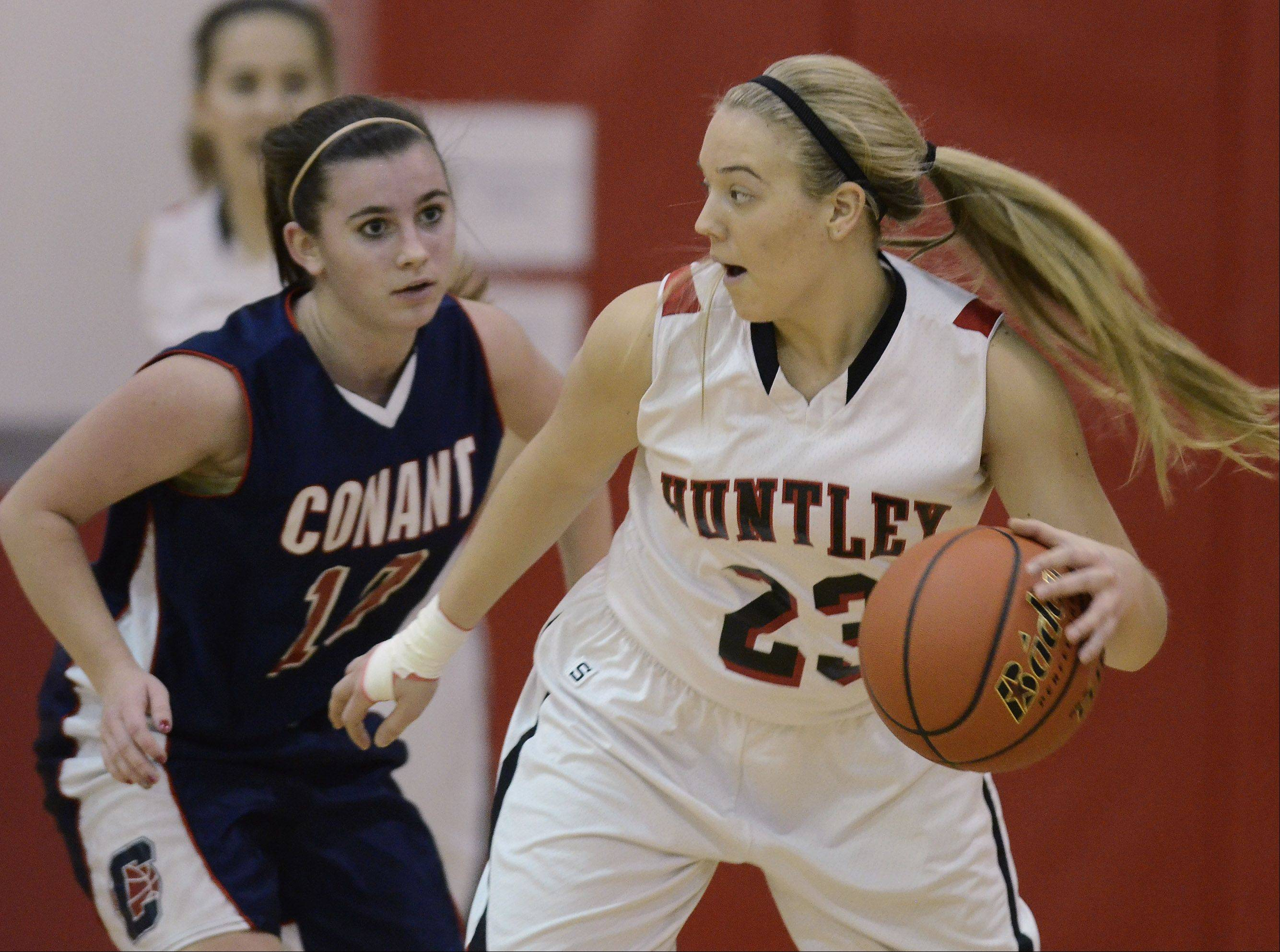 Huntley's Taylor Stone, right, tries to dribble around Conant's Sidney O'Keefe during Saturday's game at Mundelein.