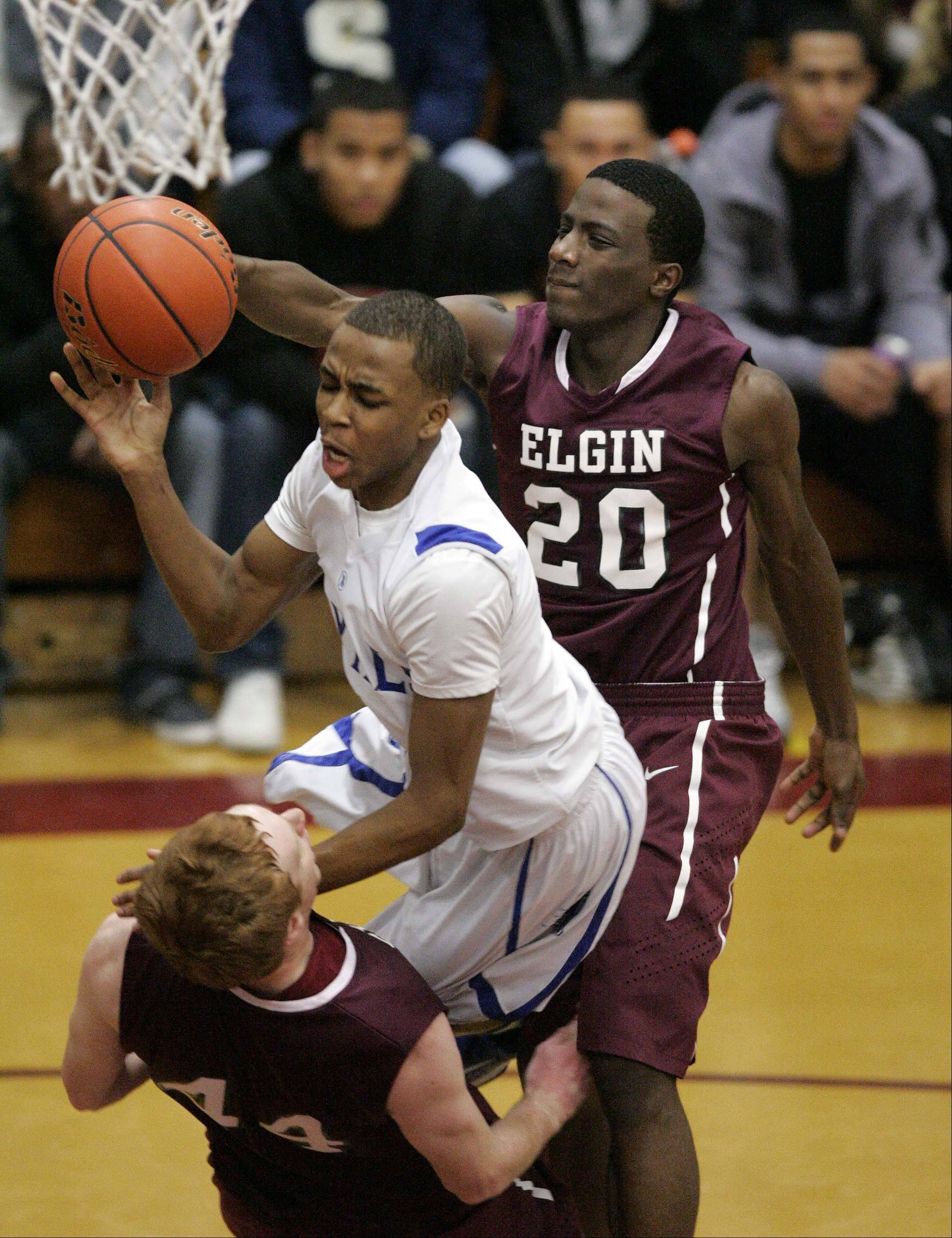 Larkin's Quantice Hunter (1) goes hard to the hoop as Elgin post Eric Sedlack (44) stands strong during the boys championship basketball game of the 38th Annual Elgin Boys Holiday Basketball Tournament Saturday, December 29, 2012 in Elgin.