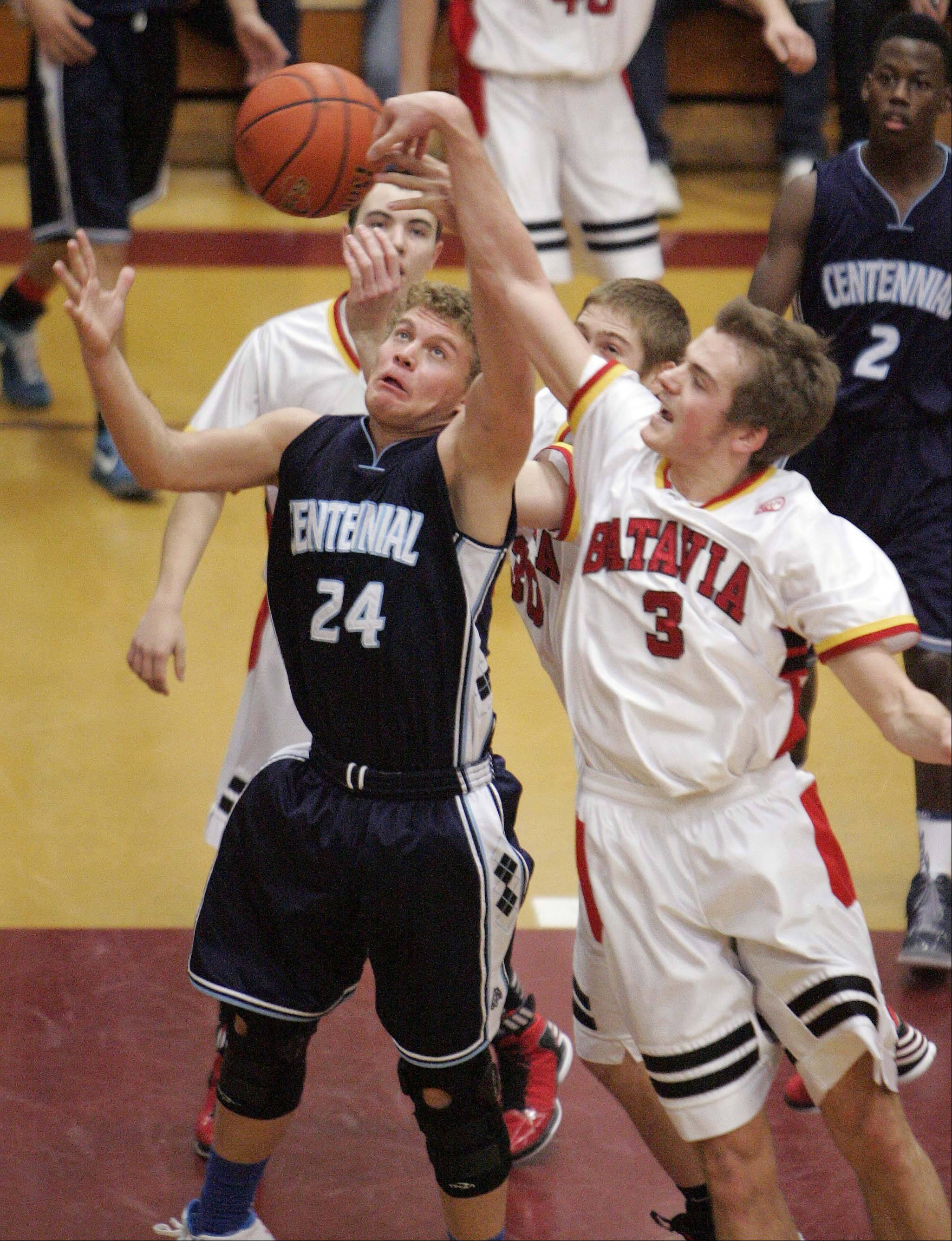 Brian Hill/bhill@dailyherald.com Batavia guard Jake Pollack (3) knocks a rebound from the hands of Las Vegas Centennial's Austin Turley, 24, during the third place basketball game of the 38th Annual Elgin Boys Holiday Basketball Tournament Saturday, December 29, 2012 in Elgin.