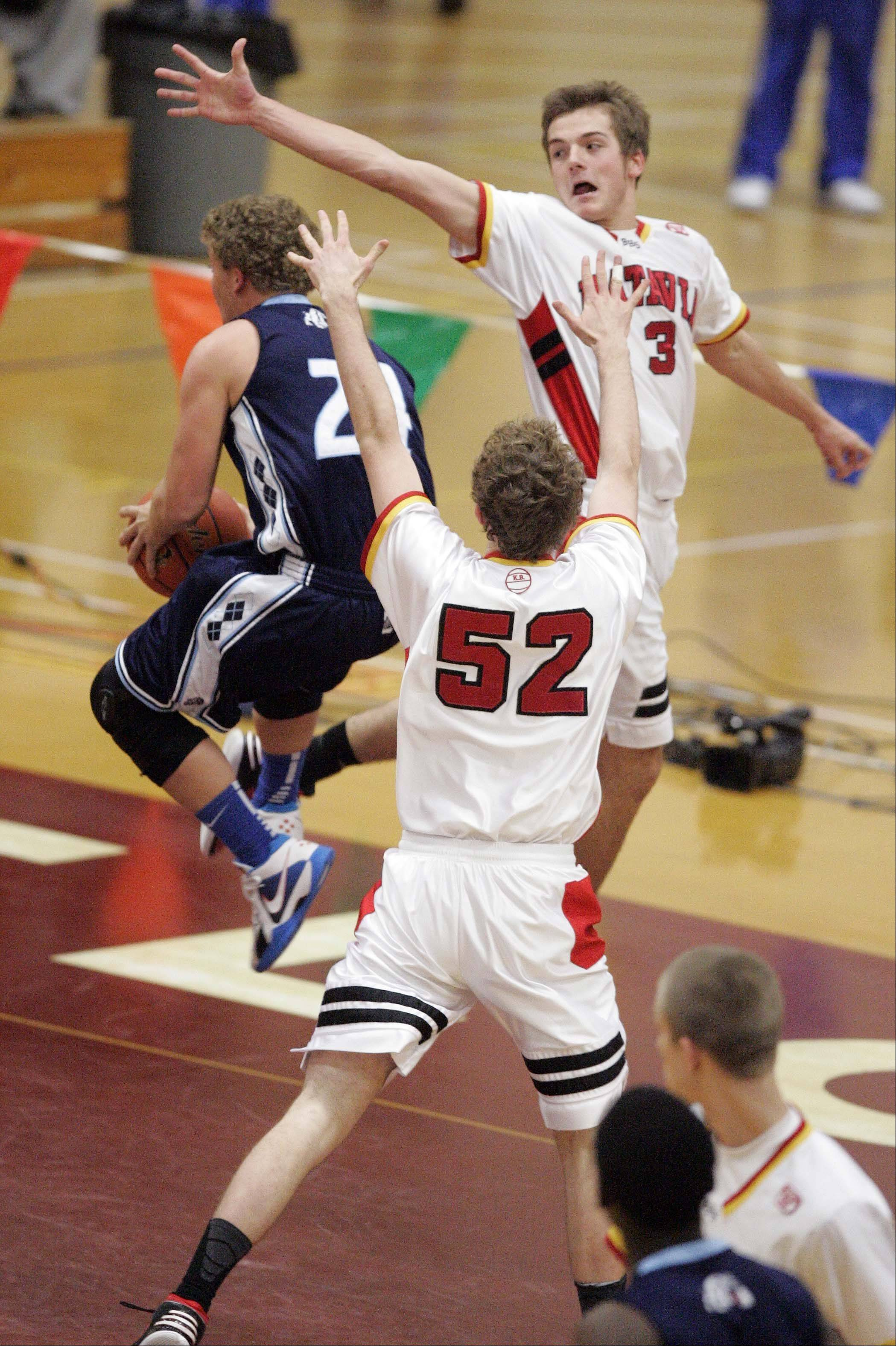 Las Vegas Centennial's Austin Turley, 24, threads his way through Batavia forward Luke Horton (52) and guard Jake Pollack (3) during the third place basketball game of the 38th Annual Elgin Boys Holiday Basketball Tournament Saturday, December 29, 2012 in Elgin.