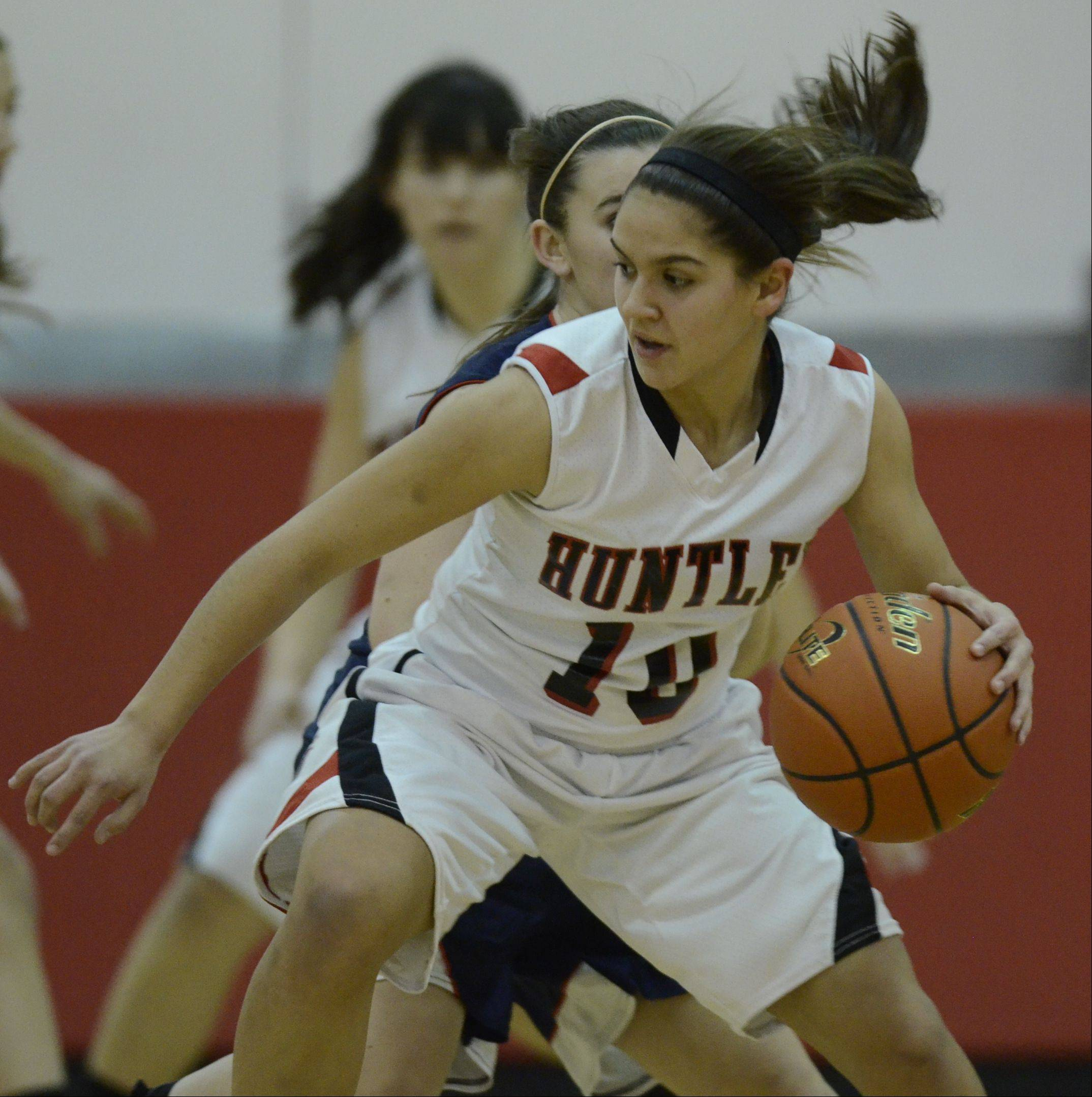 Images from the Mundelein girls basketball tournament championship game between Huntley and Conant on Saturday, Dec. 29 at Mundelein High School.