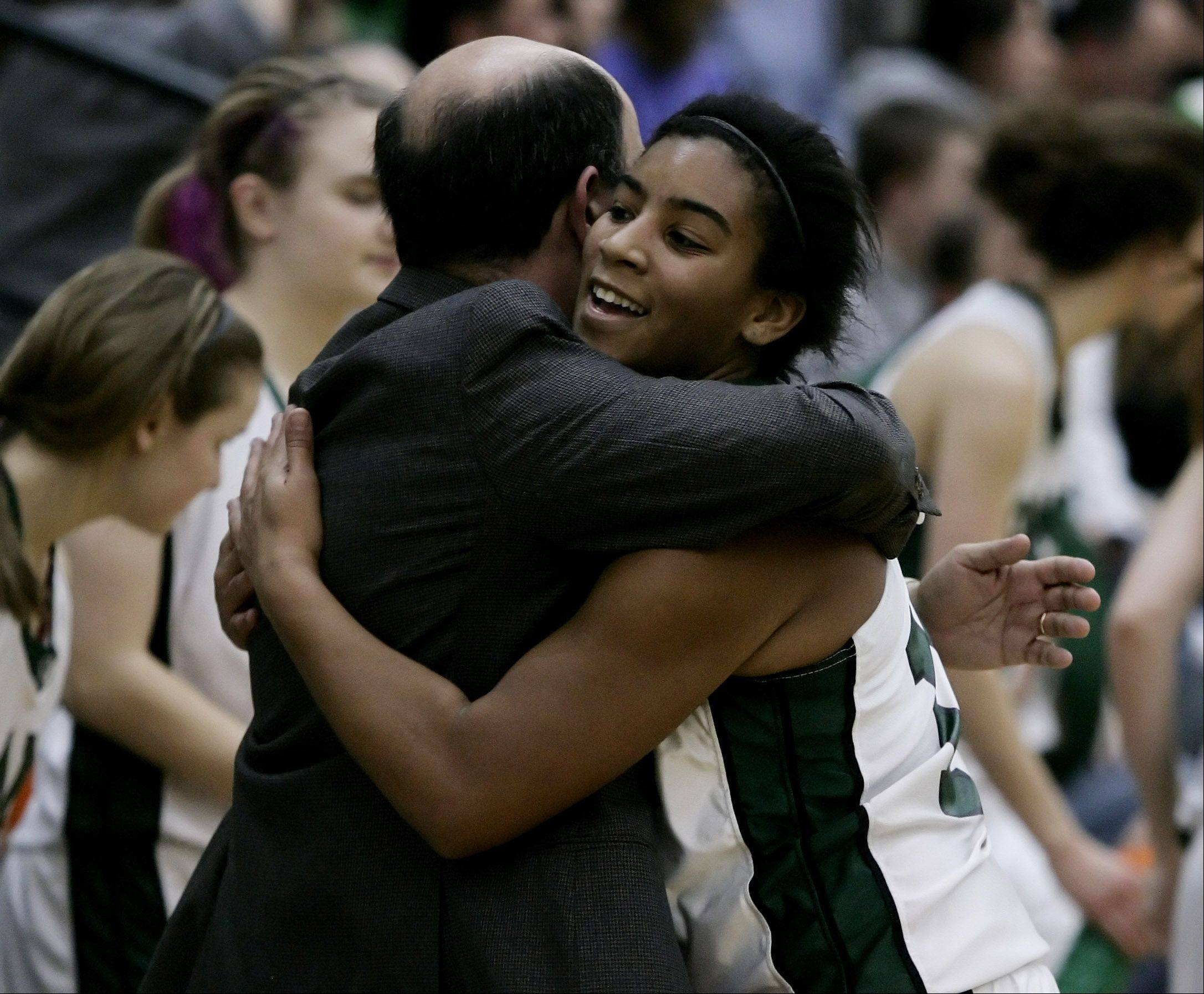 Grayslake Central guard Alex Scarbro is hugged by coach Steve Ikenn during the Class 3A girls high school sectional basketball championship against Johnsburg.