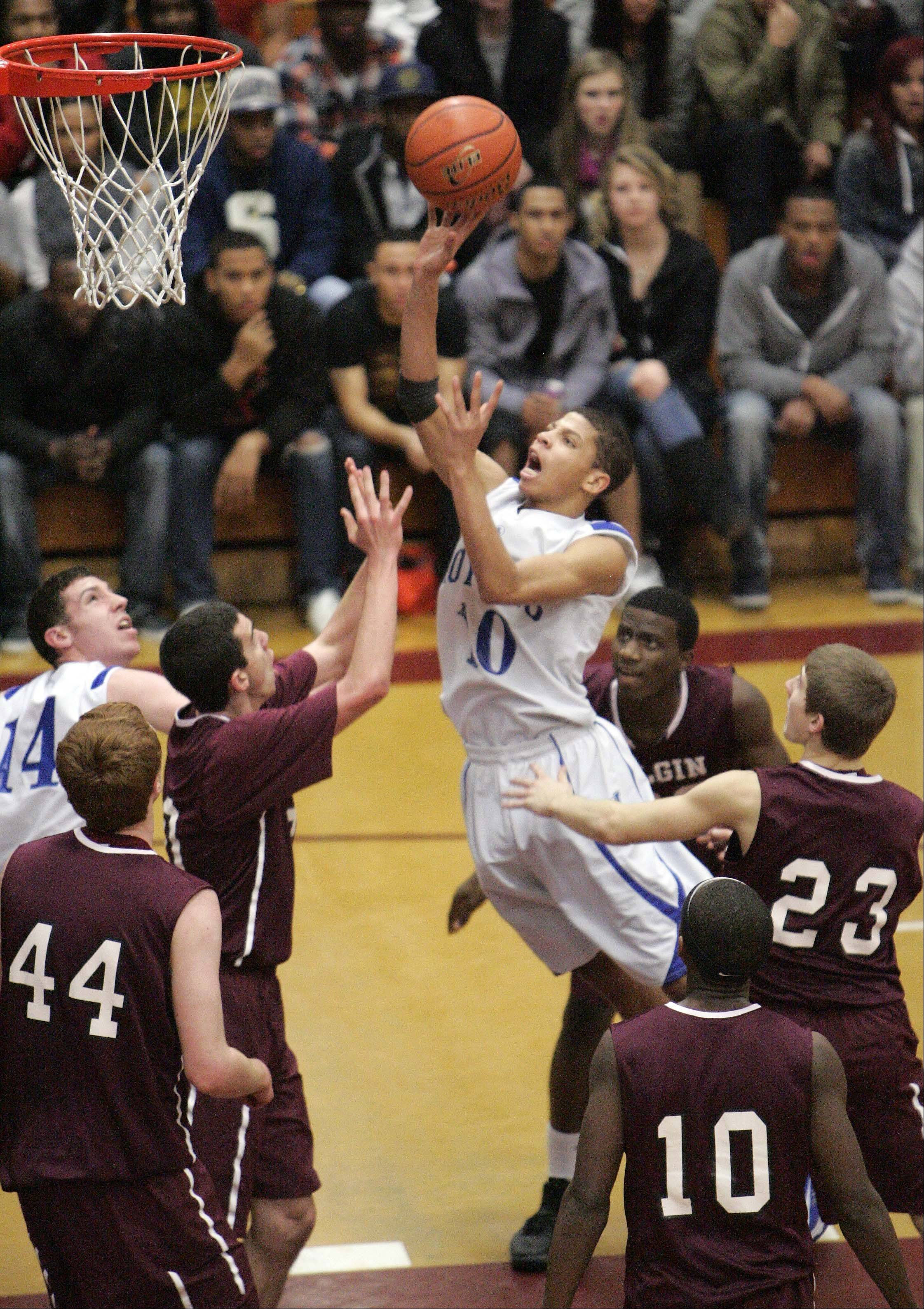 Larkin's Kendale McCullum (10) goes hard to the hoop past a horde of Elgin defenders during the championship game of Elgin's holiday tournament on Saturday. Larkin looks like the team to beat in the UEC River, while Elgin and standout guard Arie Williams have surprised while delivering a 9-7 record so far.