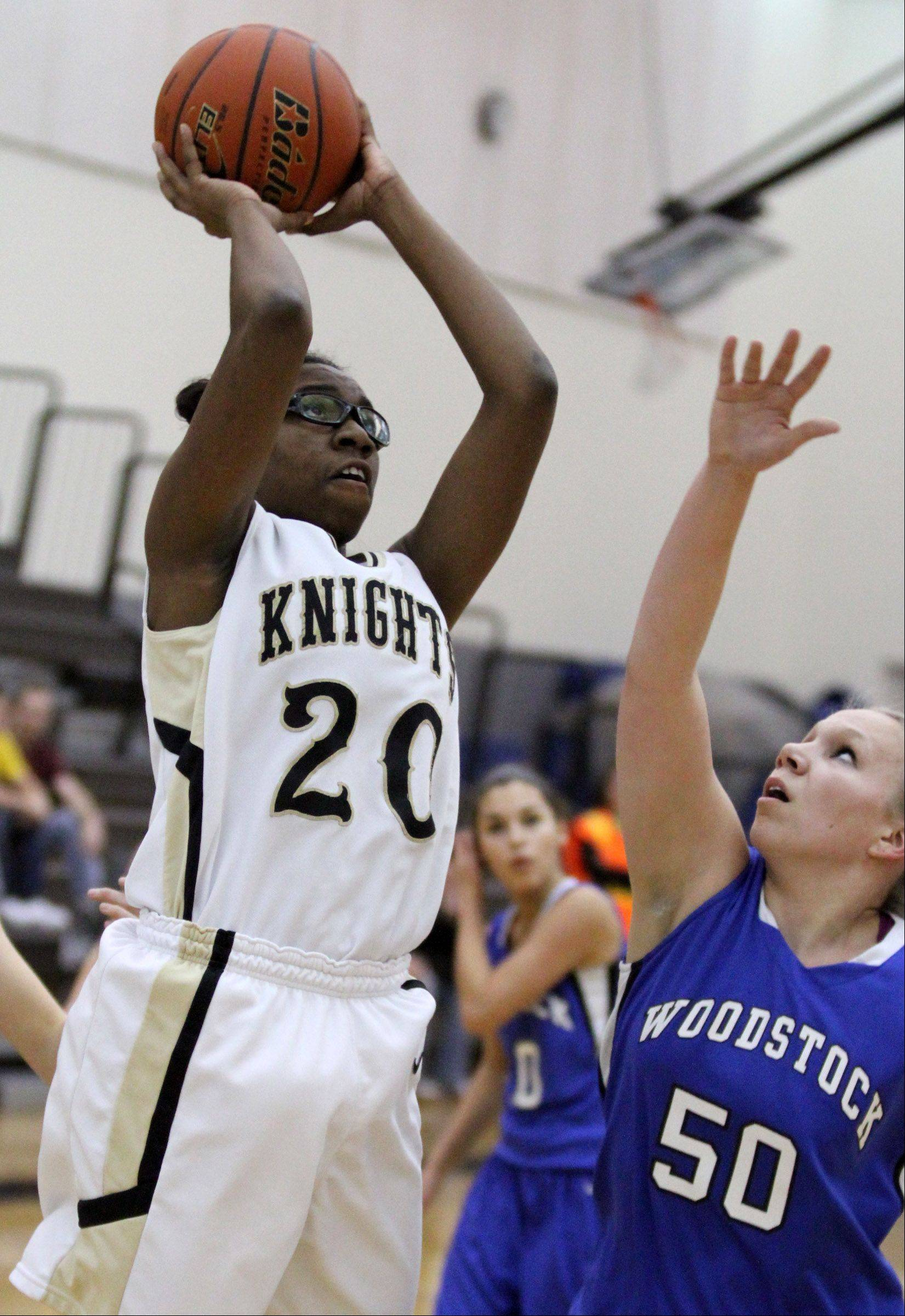 Grayslake North's Brittney Thibeaux shoots against Woodstock defender Ari Davis in Grayslake on Friday.