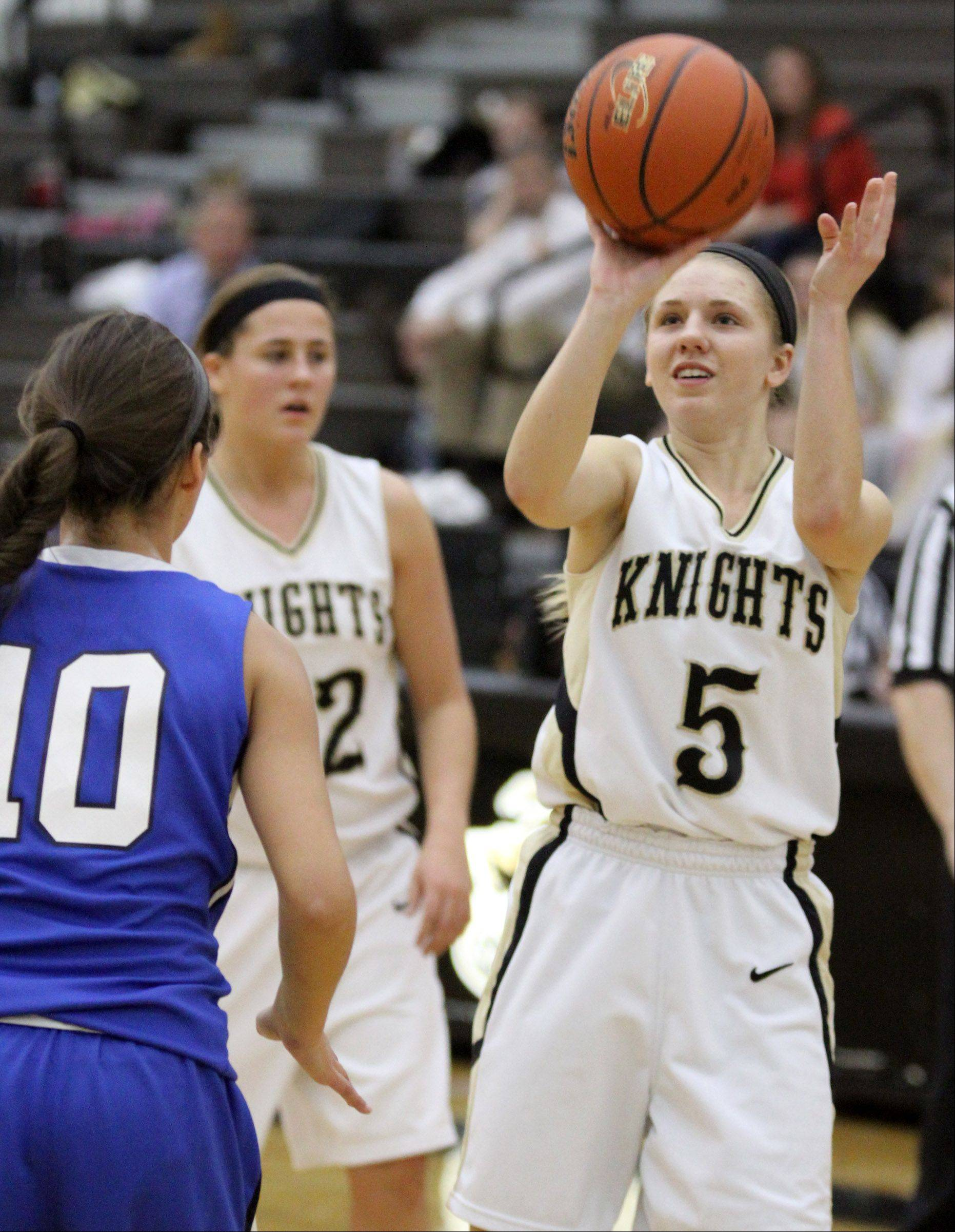 Grayslake North's Kendall Detweiler takes a shot against Woodstock.