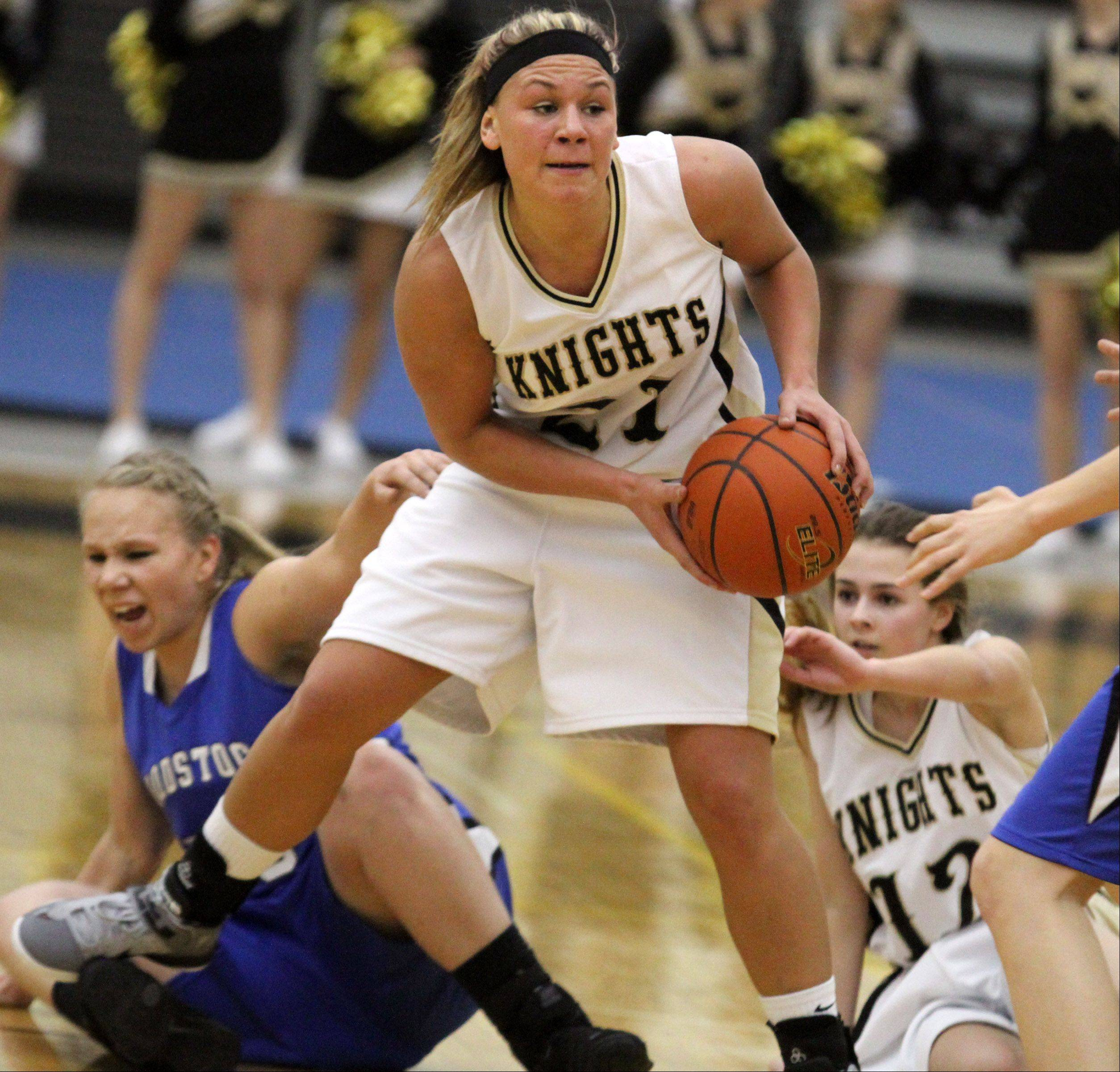 Grayslake North's Shyanne Ludwick looks to pass after picking up a loose ball against Woodstock.