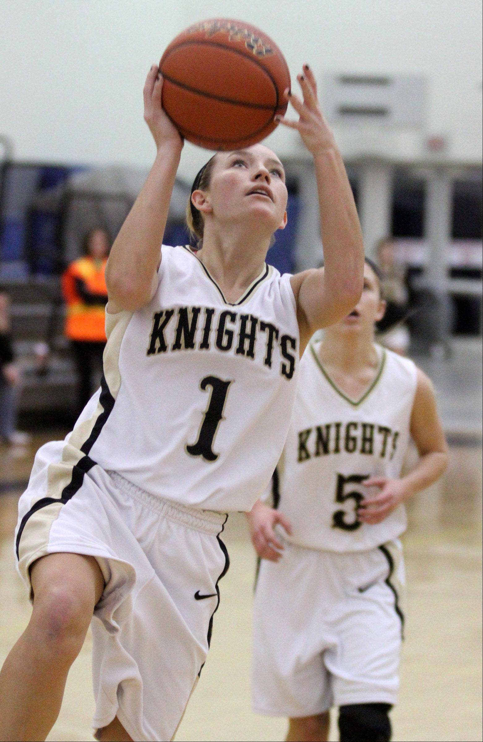 Grayslake North's Jordyn Bowen shoots a breakaway layup against Woodstock.