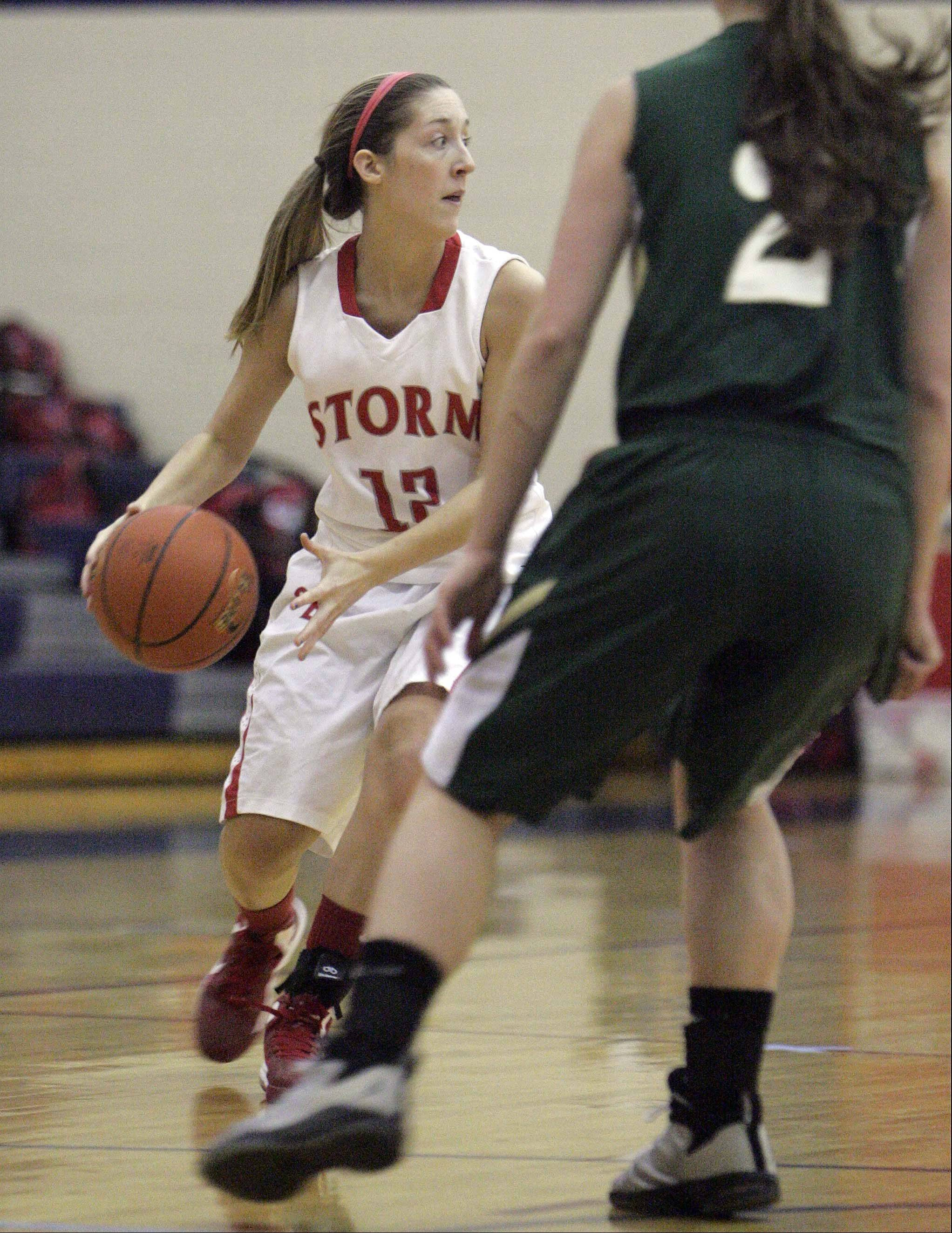 South Elgin's Nell Wentling (12) dribbles upcourt against St. Edward Saturday.