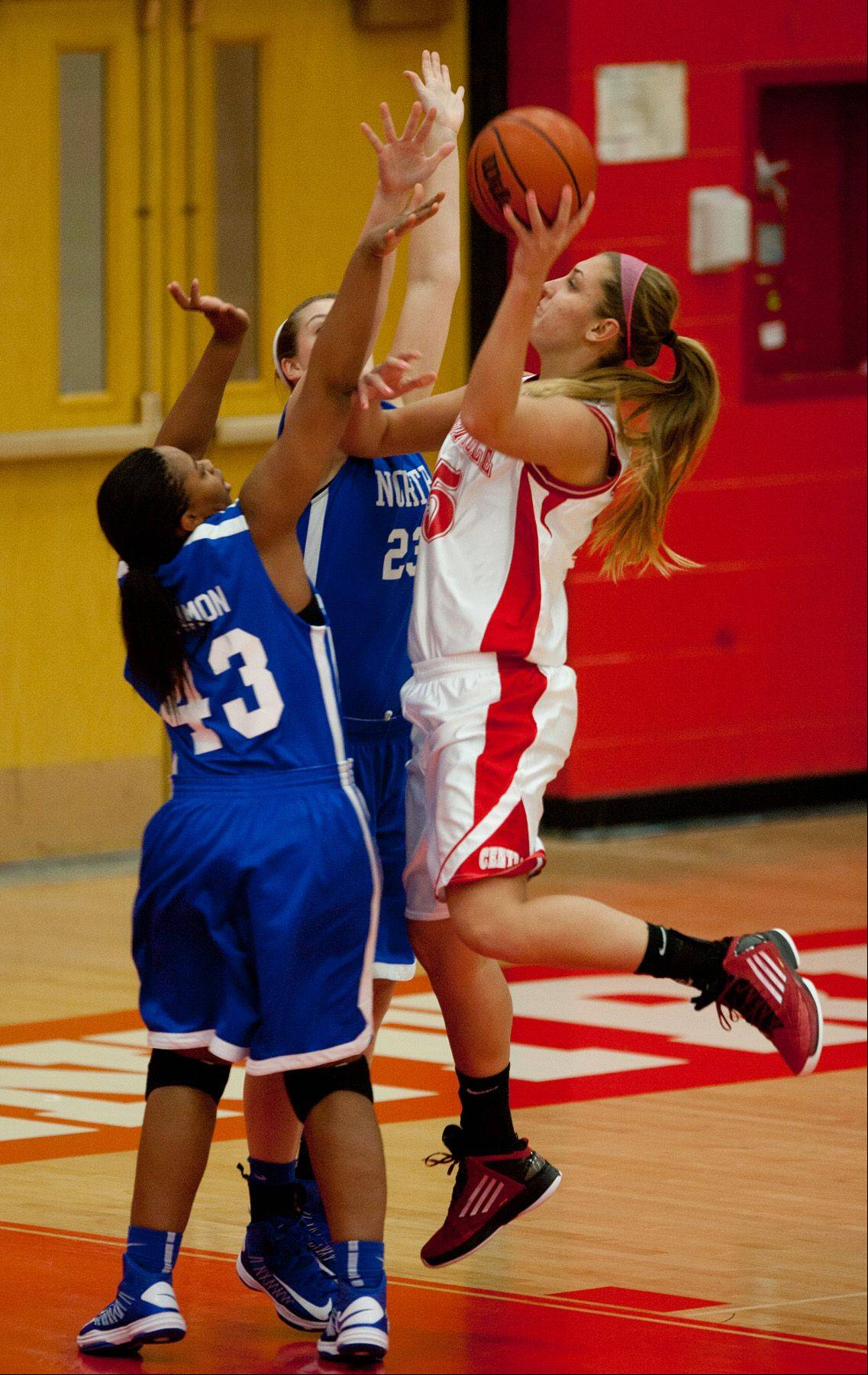 Naperville Central's Victoria Trowbridge shoots over Wheaton North, during girls basketball action in Naperville.