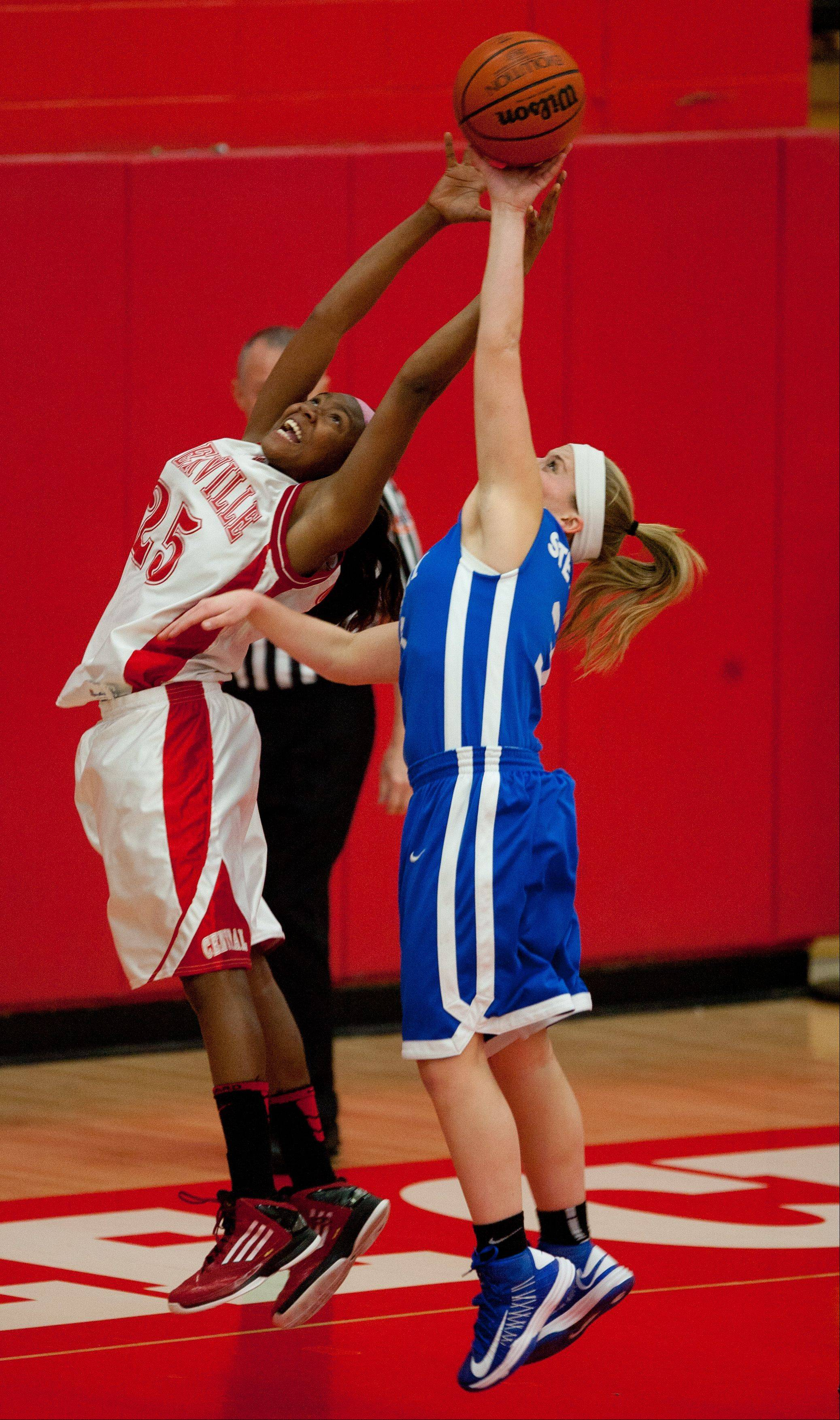 Naperville Central's Cierra Stanciel, left, looks to gather a rebound against Wheaton North on Saturday.