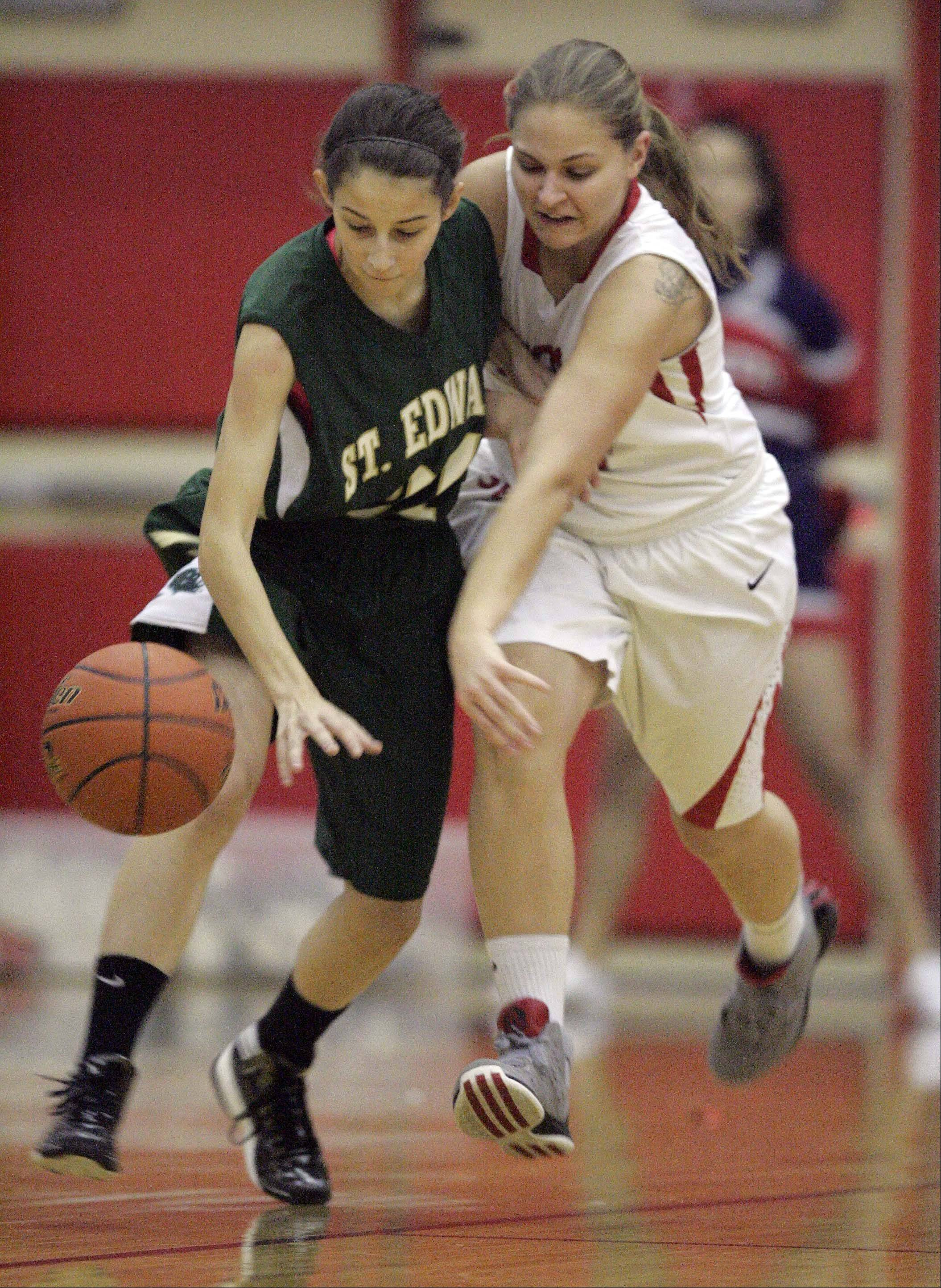 St. Edward's Chelsea Gnan, 31, puts the pressure on 34 South Elgin's Amanda Behles, 34, during girls basketball Saturday January 5, 2013