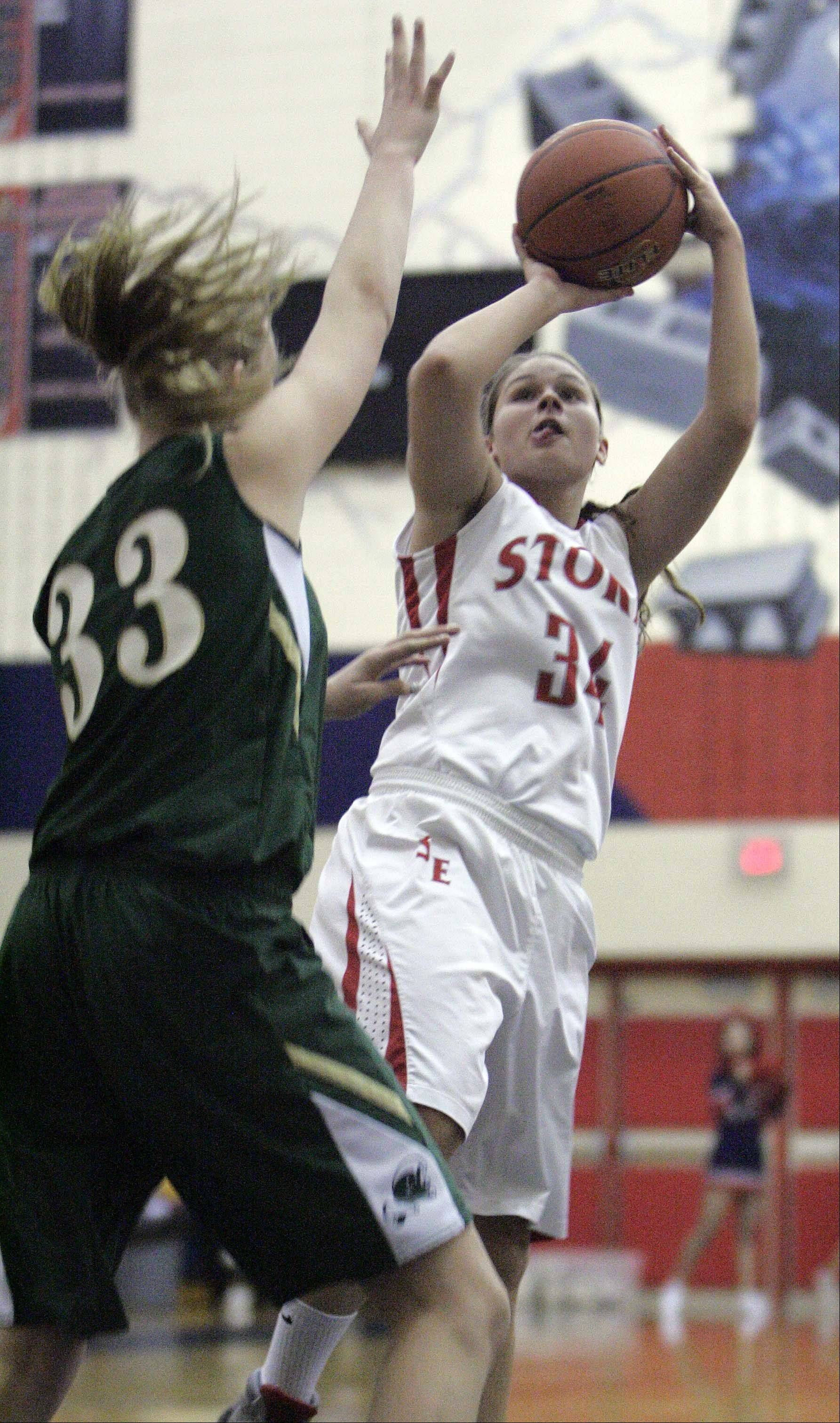 St. Edward's Cecile Rapp, 33, tries to stop South Elgin's Amanda Behles, 34, during girls basketball Saturday January 5, 2013