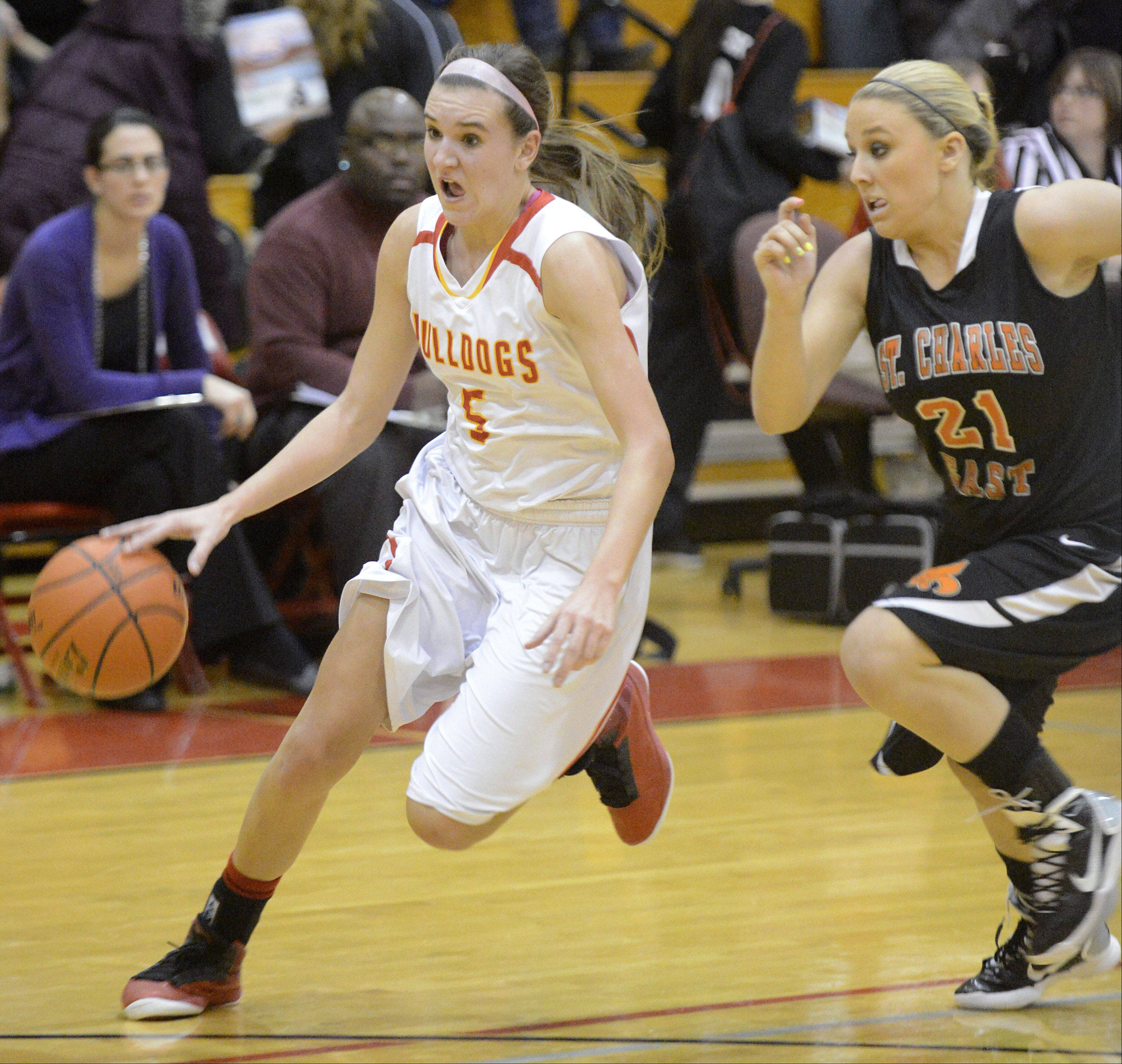 Batavia's Liza Fruendt speeds past St. Charles East's MacKenzie Meadows toward the hoop in the second quarter on Tuesday, January 8.