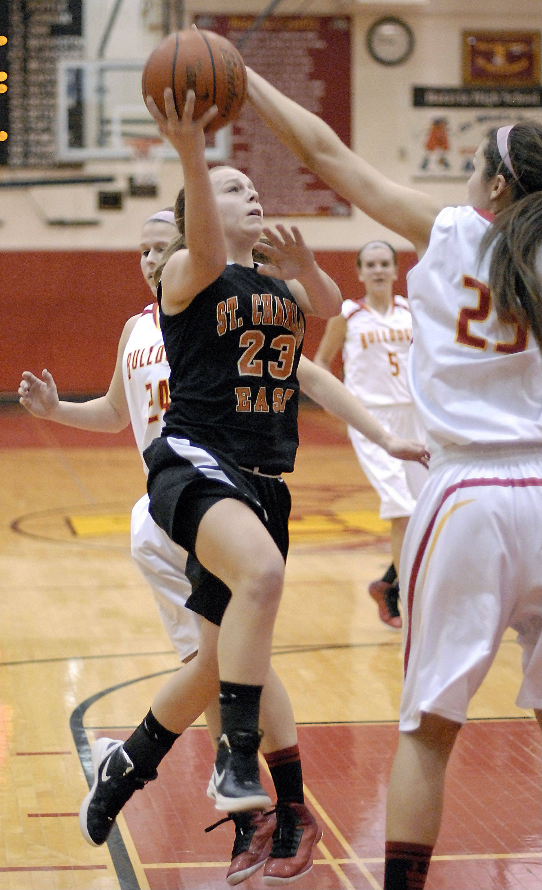 Batavia's Hannah Frazier denies St. Charles East's Amanda Hilton a shot in the second quarter on Tuesday, January 8.