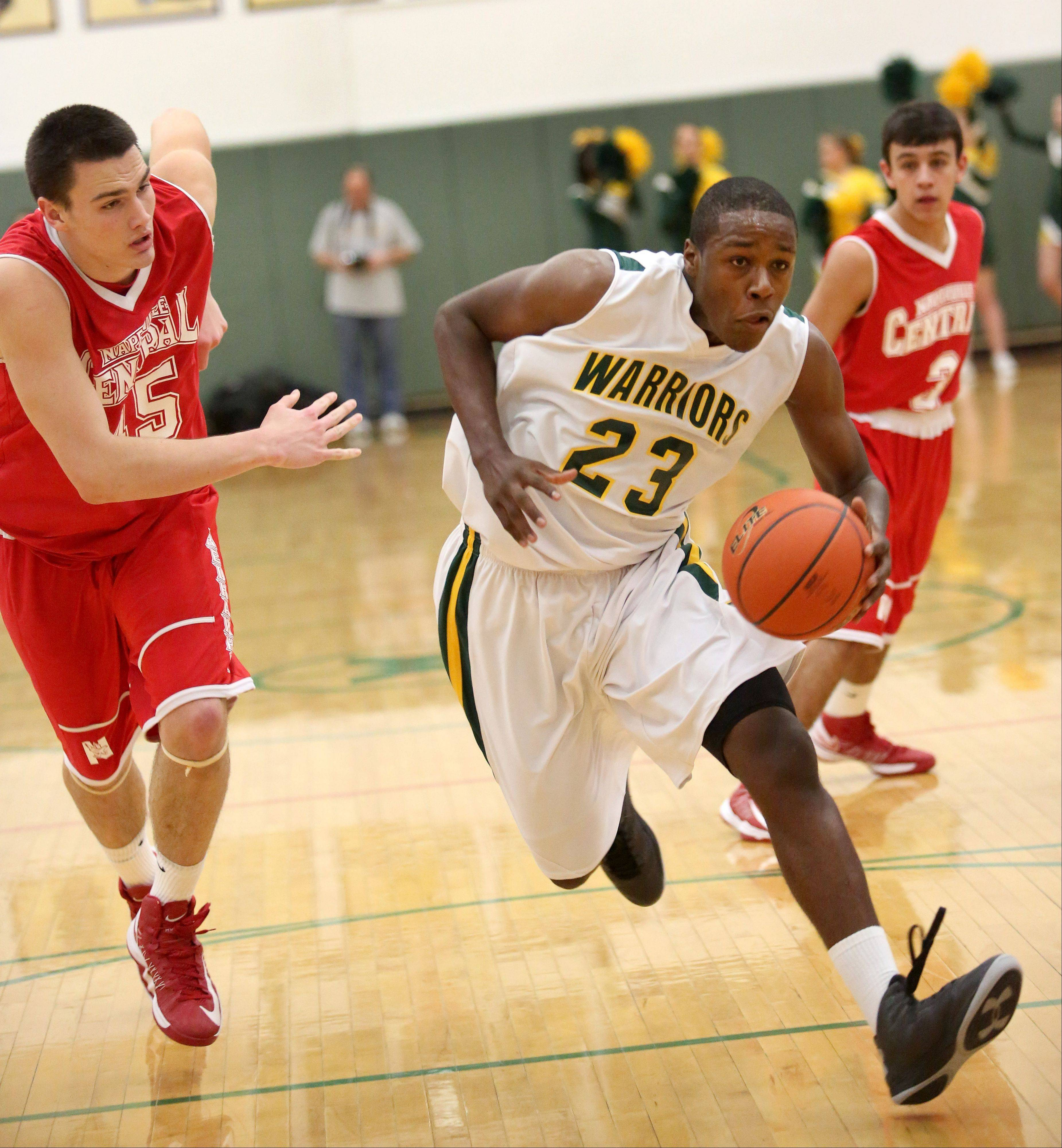 Jared Brownridge of Waubonsie Valley moves through Naperville Central defense to the basket in boys basketball action on Tuesday in Aurora.