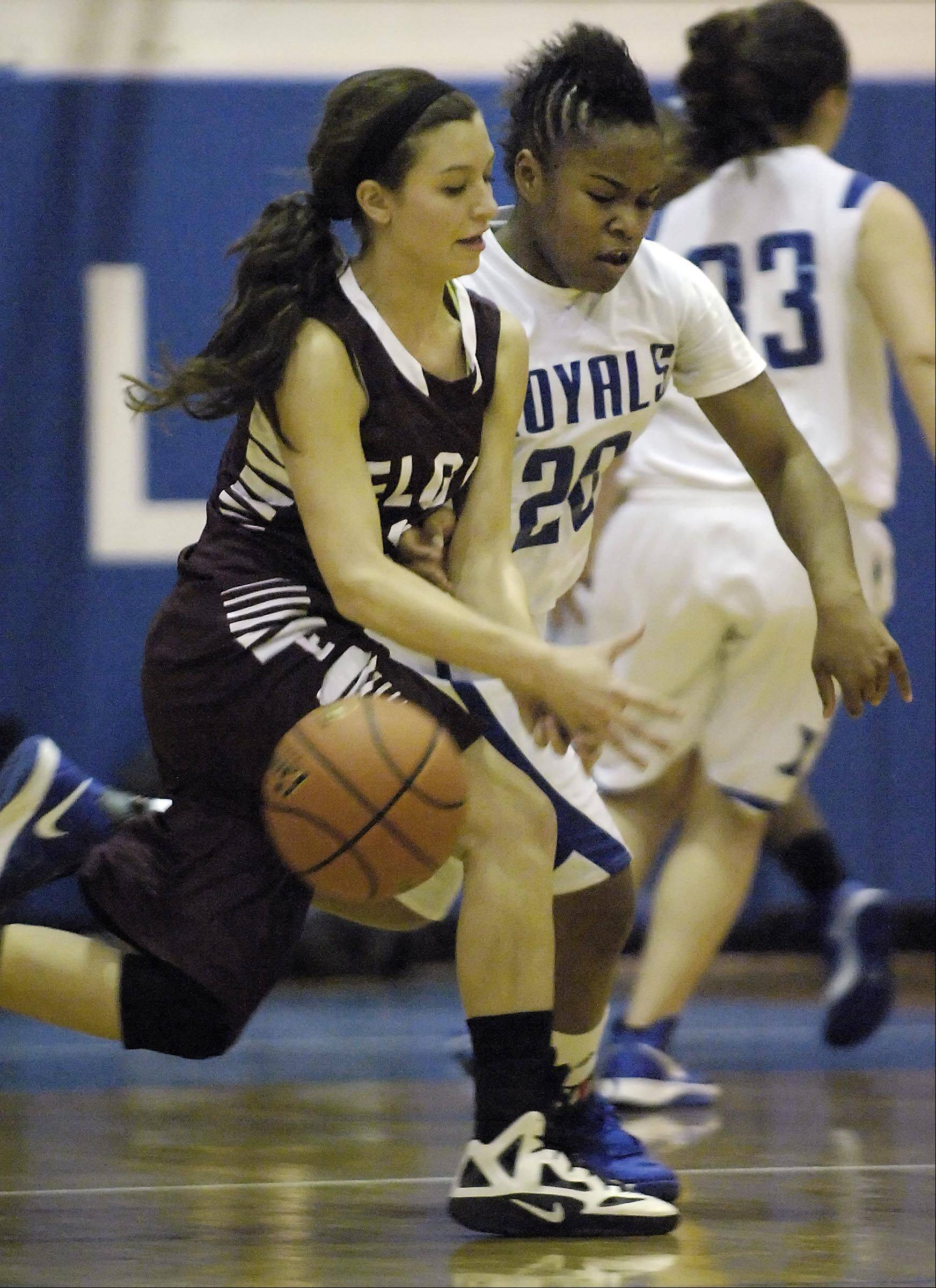 Larkin's Quixmia Washington (20) punches the ball away from Elgin's Maggie Powers Tuesday at Larkin High School in Elgin.