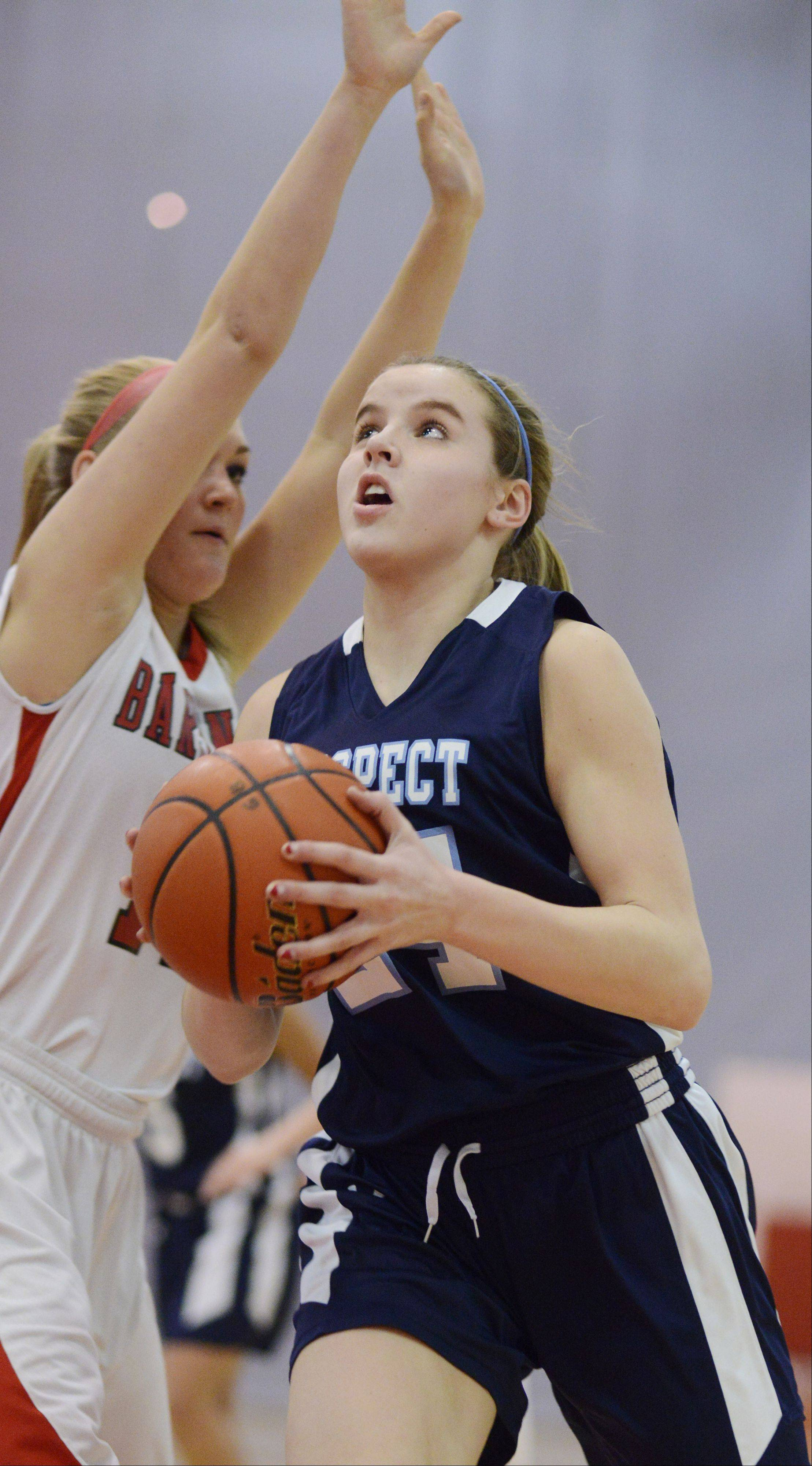Prospect's Catherine Sherwood, right, drives to the basket against Barrington's Maddie Bartz.