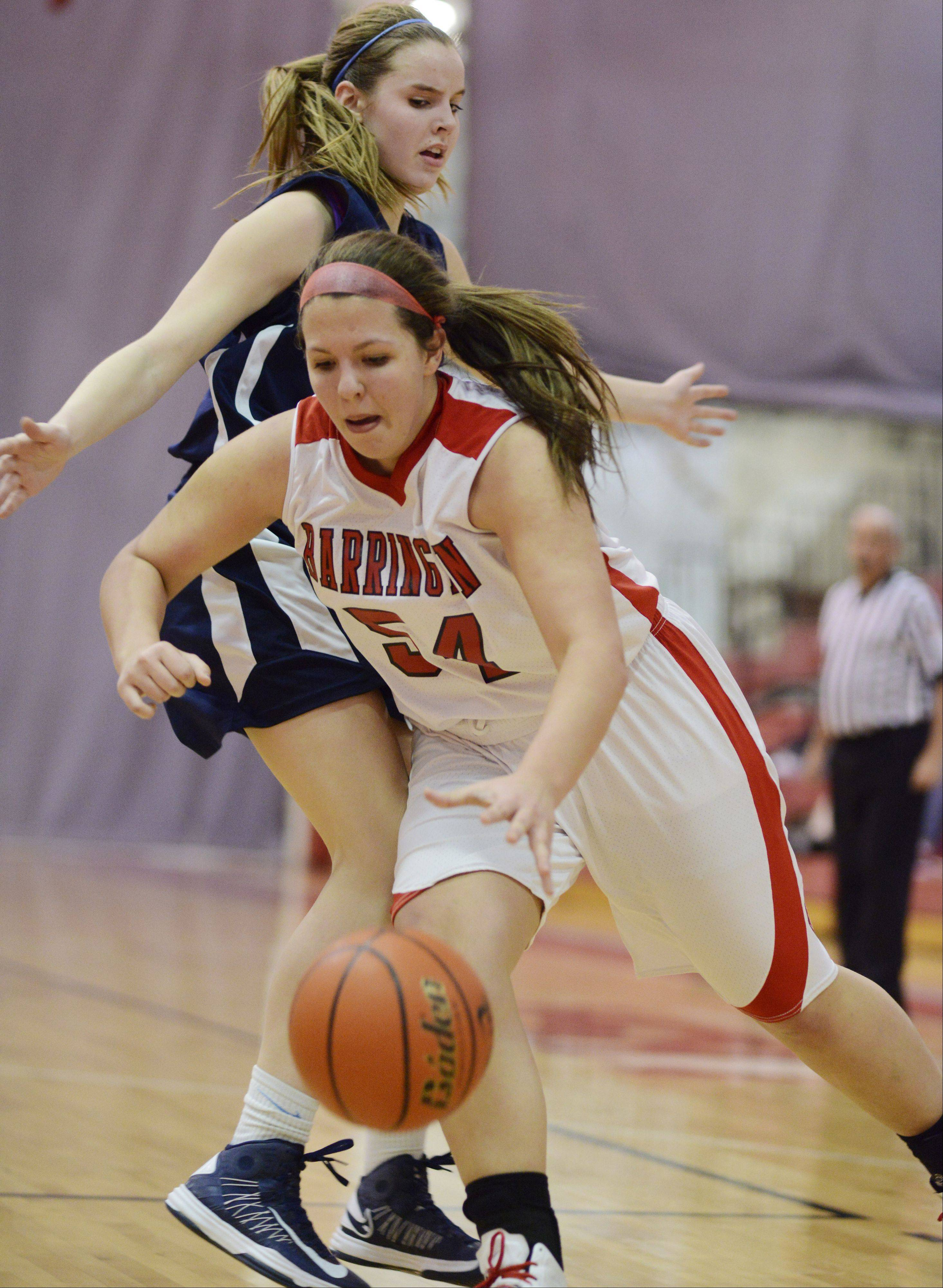 Barrington's Alexa Resch drives to the basket against the defense of Prospect's Catherine Sherwood.