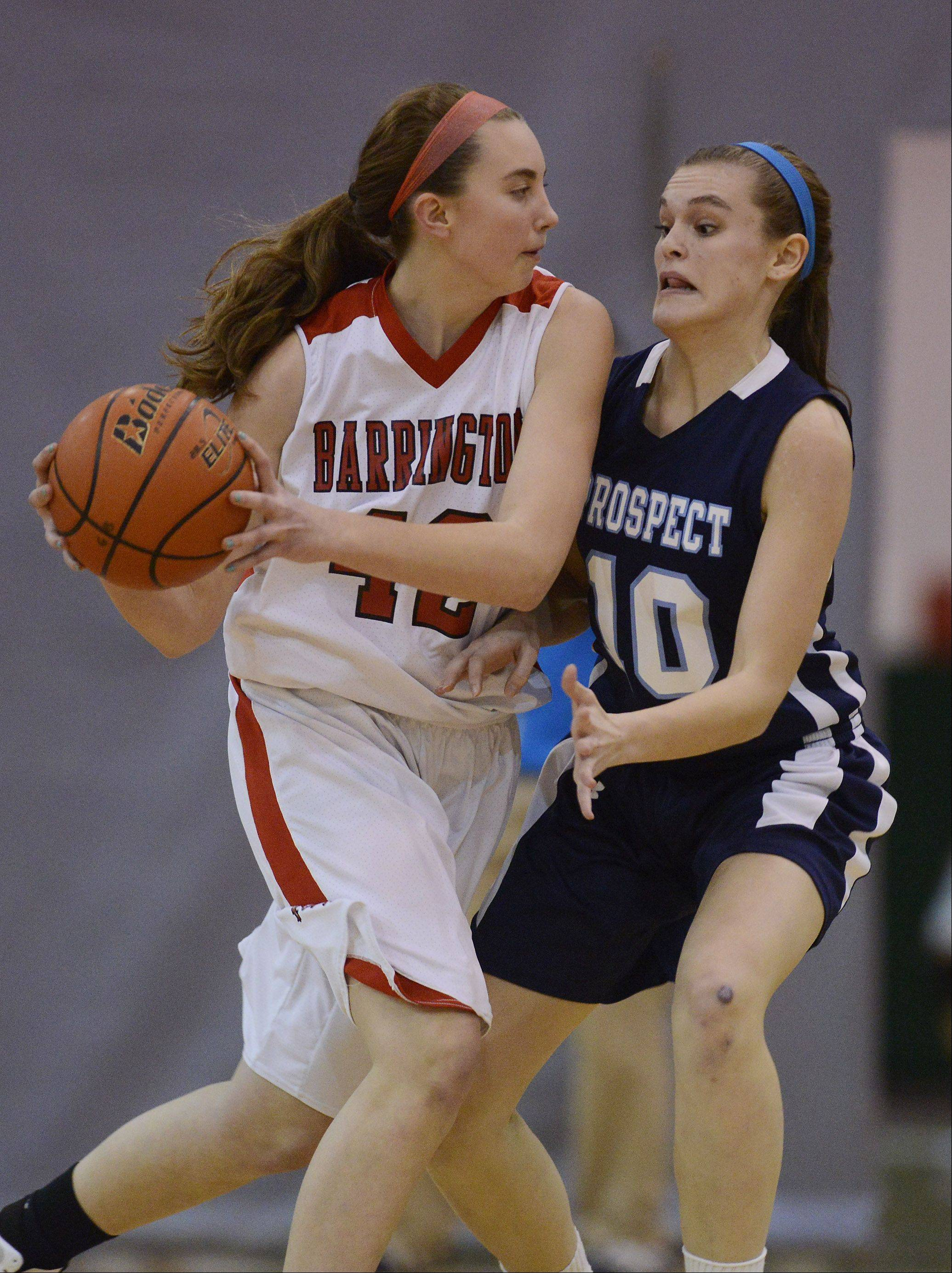 Barrington's Megan Talbot, left, is closely guarded by Prospect's Taylor Will.